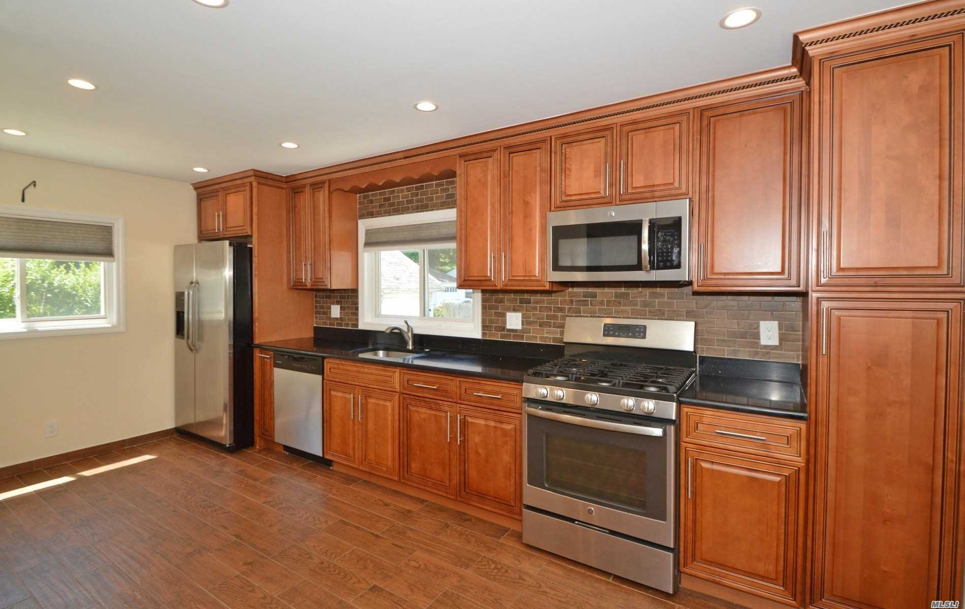 Lynbrook Updated 2 Bedroom Apartment , 1.5 Baths, Features Large Eik, Living Room, Hardwood Floors Thru Out, Parking Allowed In Driveway, Use Of Back Yard, Includes Washer And Dryer, Addl Storage In The Basement... Includes Flat Screen Tv
