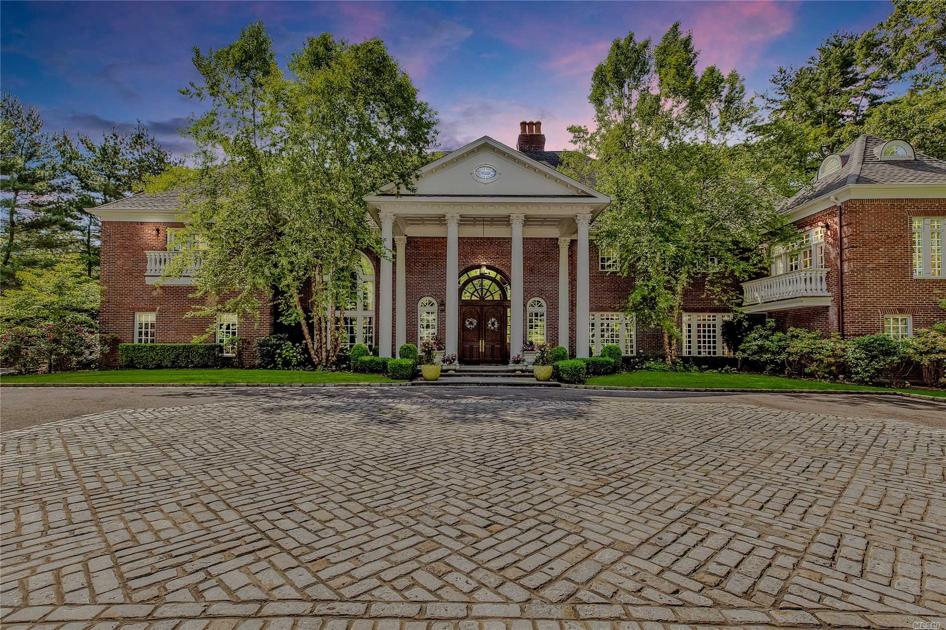 Oyster Bay. Unique & Eminent Brick Colonial In The Village Of Matinecock. This Remarkable 6-Bedroom, 6.5 Bath Home, With Intricate & Charming Detailing Throughout, Features Kitchen With 2 Granite Islands, Bar Area, Sitting Room With Cupola, Library With Built In Cabinetry & Hidden Doors, Elegant & Beautiful Moldings, Coffered & Vaulted Ceilings Throughout. Featuring Ig Heated Pool With Pool House, Hartru Tennis Court, Golf Tee & Koi Pond. All Situated On Over 5 Private Acres & Much More.