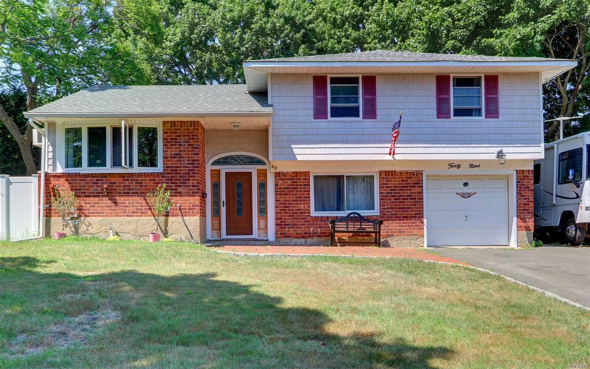 Lovely Split Level Home Hard Wood Floors Throughout, Nice Fenced In Property,  Updates Include New Gas Heating System, Anderson Windows, Roof,  And Much More. Tree Lined Residential Street With Sidewalks. Close To Parkways, . Shopping And Beach. Possible Mother /Daughter With Permits.