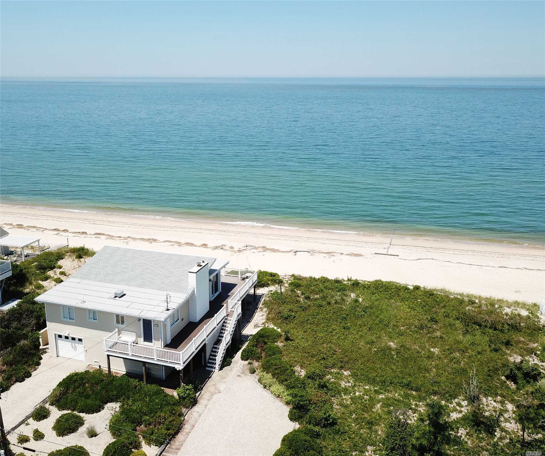 Long Island Soundfront With Panoramic Views And 100Ft. Of Deep Sandy Beach. Original Seasonal Beach Cottage Is A Distant Memory Replaced By A Completely Renovated Home Designed With Simple High End Sophistication. Easy Breezy Whitewashed Open Space Enclosed By Big Picture Windows To Let The Visions Of Water And Sand Sooth The Stresses Of The Work Week. Big Wrap Around Deck And Let Us Not Forget The Unforgettable Sunsets!