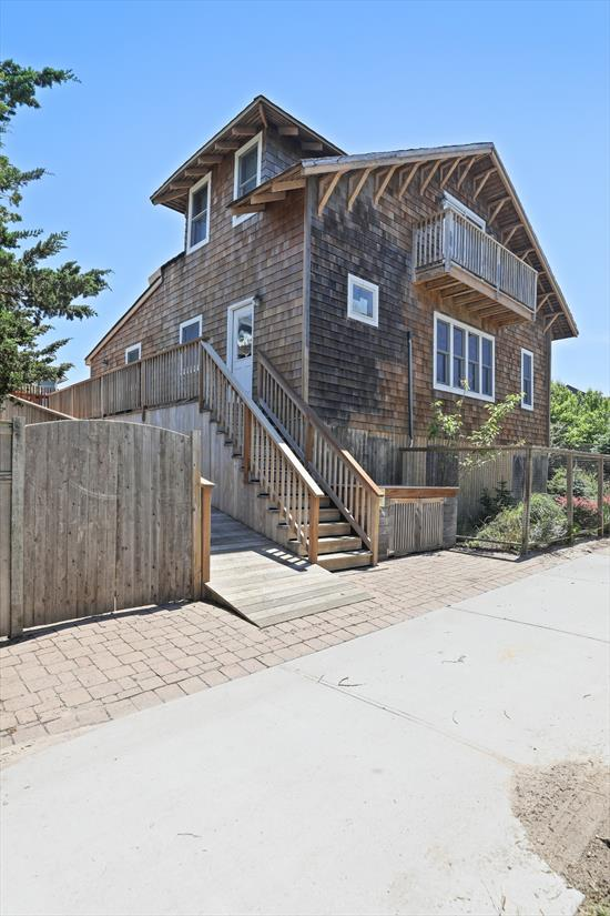 This spacious 4 bedroom, 2.5 bathroom, home is the second house back from the beach! The master suite and upstairs deck enjoy beautiful ocean views!  New pool installed in the summer of 2018.  Ready to enjoy! <BR> The main floor has a gracious floor plan with high ceilings, tons of windows, and natural sunlight pouring in. The open living room, dining room, and kitchen makes this home ideal for entertaining. The living room features comfortable seating for 6 guests with a flat screen TV (including satellite TV, DVD player, CD player, and sound system and games for the whole family). The open kitchen has everything that you need including a breakfast bar with seating for four, microwave, ice maker, coffee maker, electric stove, toaster, blender, all pots & pans, cutlery and dining ware. The indoor dining room table has comfortable seating for six. The great room flows out to the spacious deck through multiple glass sliding doors. The main deck is extremely large with an outdoor dining table for eight guests, an additional high top table for three, a propane grill, and an outdoor shower. The home has air conditioning and heating for your comfort in all seasons, and is also equipped with WIFI. <BR> The layout of the home is ideal for two families sharing, with a master suite and additional bedroom on each floor. The upstairs master has a queen sized bed, separate seating area, walk in closet, and two private decks. There is an en-suite full bathroom, which can also be accessed from the second upstairs bedroom, which has two twin beds. The downstairs master bedroom has a queen-sized bed and an en-suite full bath. The fourth bedroom has a queen sized bed.  <BR> This home is located in the Village of Ocean Beach, a family friendly community that features lifeguarded beaches, tennis courts, basketball courts, marina, and a playground. Ocean Beach is the unofficial capitol of Fire Island. Its commercial district is the largest on the island, spanning 7 blocks across the length of Bay Walk and featuring a number of restaurants, bars, and shops. <BR> Please note this home is not available on Craig's List; If someone is presenting it there, they are attempting to scam you. <BR> Pets are welcome at this property but an additional $250 refundable deposit is required.  <BR>  <BR> July 1st-31st: $50,000 <BR> August 1st-September 7th: $62,500