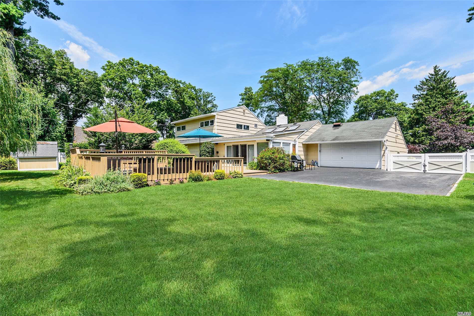 Beautiful, Move In Country Club Expanded Ranch. Entry Hall, Glass Walled Great Room With Fireplace Overlooking Manicured Lush Property With Large Deck And Hot Tub Spa, Formal Dining Room, Gourmet Granite & Stainless Steel Eat-In Kitchen, Master Suite With Full Bath, Br, Fbath. Upstairs Features Two Bedrooms, Full Bath And Storage. Wheatley Schools, Low Low Taxes. A Winner.
