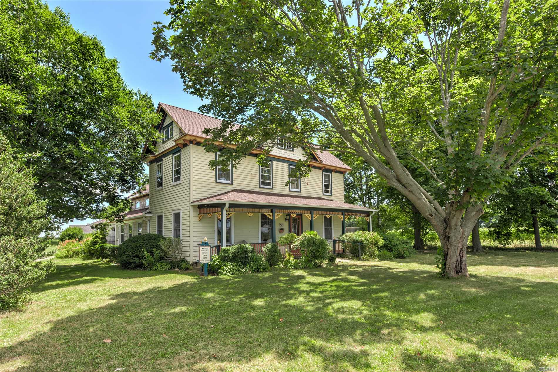 Circa 1873 Moses Lindsay House. Rare Opportunity To Own A Real Piece Of North Fork History. Fabulous Exposure, Yet Privately Surrounded By 35 Acres Of Stunning Vineyard Views On All 3 Sides. Lovingly Maintained, Charm Abounds, Acre Of Land, Vintage Outbuildings, Majestic Old Trees. Spacious Rooms To Entertain, Many New Costly Upgrades, Adorable Granny Attic, Central Air Comfort. Pamper Lucky Dinner Guests Or Host Family Events Under Twinkly Evening Lights Along The Vines. Romance Is In The Air.