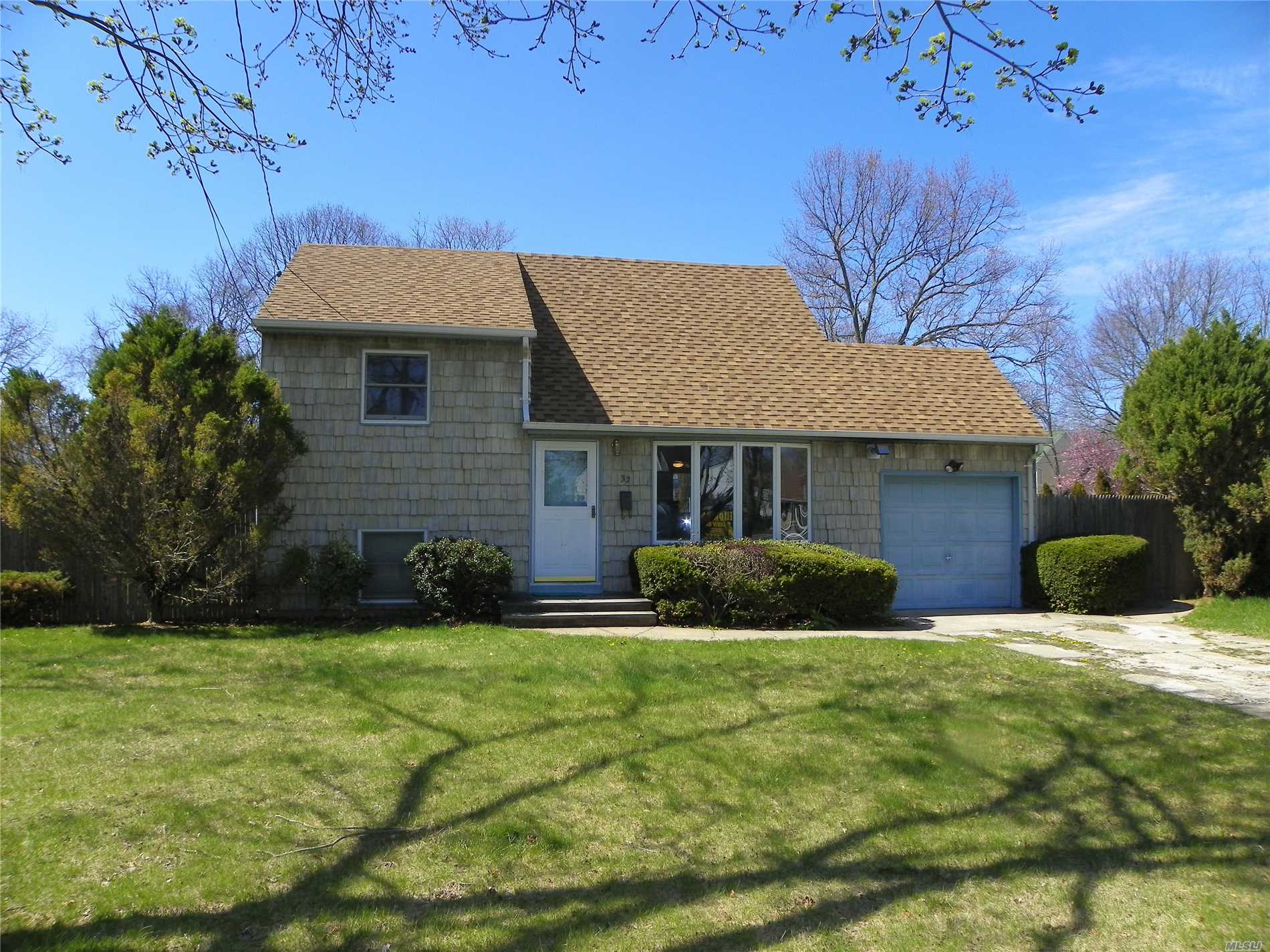 Adorable Split With Updated Kitchen Cabinets, 200 Amp Electric Service, Anderson Windows,  Efficient Pellet Stove, Hardwood Floors, Fenced In Rear Yard,  On A Corner Lot.