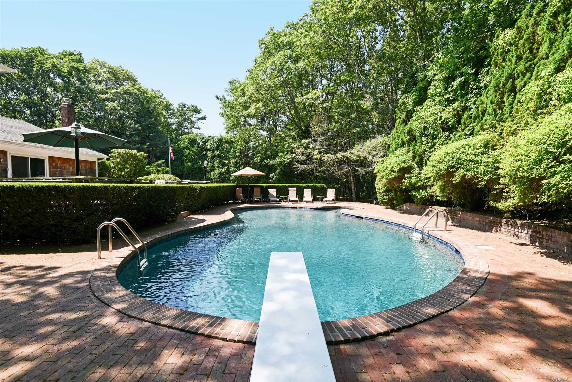 Come See This Neat As A Pin Four Bedroom Two And Half Bathroom House On A Full Acre In The Wonderful Village Of Quogue. There Is An Eat In Kitchen, Dining Area, Living Room, Den, Two Car Garage, And A Finished Basement The Back Yard Is Very Private With A Large Deck And Fabulous Gunite Pool.