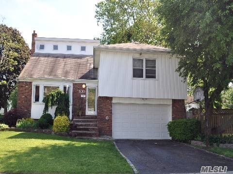 Amazing Big Bold Split Totally Minted Out, 2nd Master Is A Bonus!Finished Basement, Granite/Wood Eik, Stainless Applnces, Alarm, Gleaming Hrdwd Flrs, New Wndws, Fence, Big Yard, Pavers, Wine Frig, Cozy Den, Upgrades Galore, Sliders To Great Deck, Beautiful Block In Prime Old Britton Estates.Unreal Curb Appeal Too!