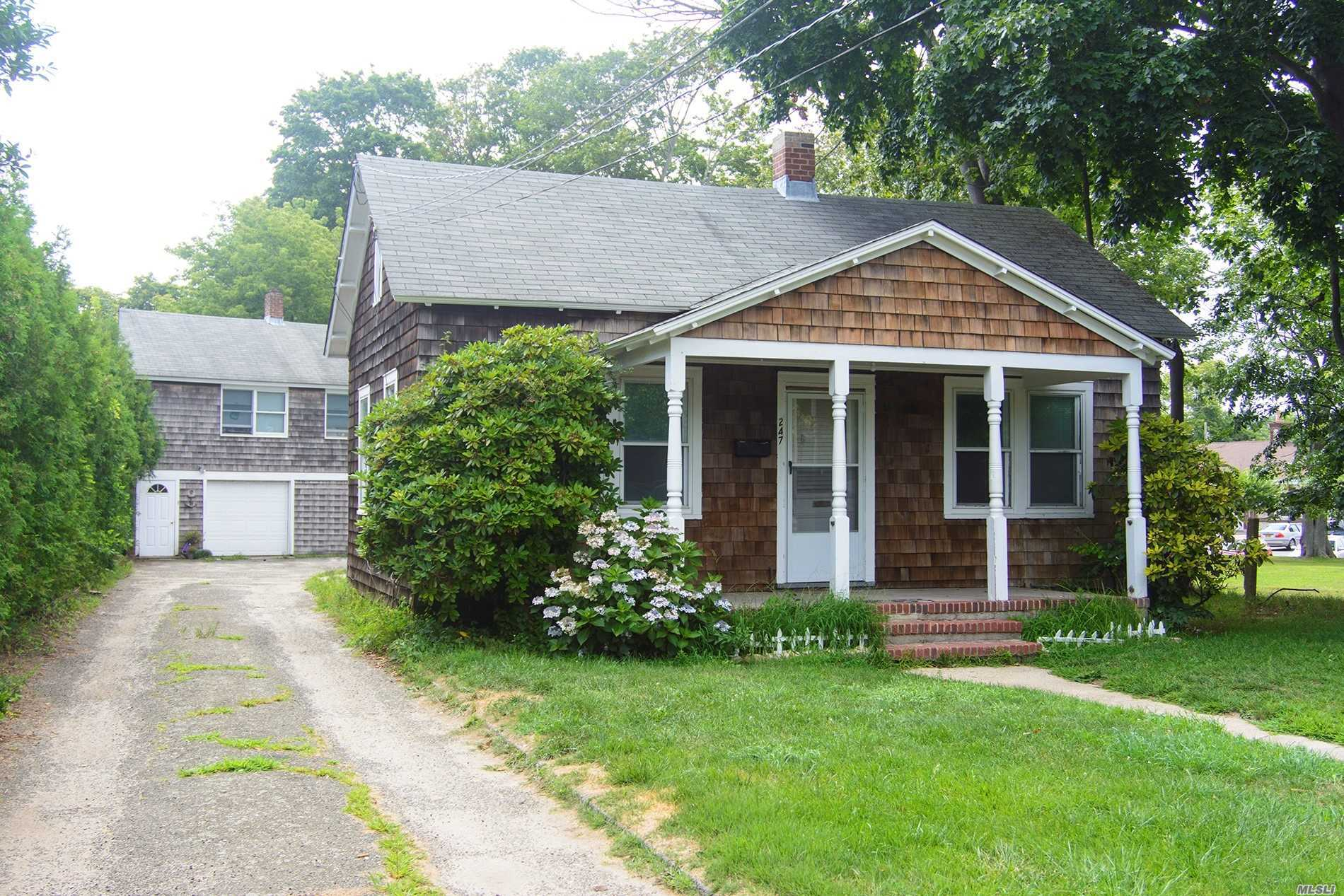 Improved Price!! Motivated Seller!! Literally Steps Away From The Lirr And Hugged By Surrounding Trees, Sits This Ample Village Home, In Need Of Tlc, With An Accompanying Building That Offers A Garage And Legal 2nd Floor Apartment W/Tenant Who Is Prepared To Depart Upon Purchase, But Is Willing To Stay If Agreed Upon With Purchaser. Minutes Away From Village Shopping, Eateries And Entertainment. Potential Pool Setbacks 20' Side And Rear. Significant Potential And A Commuter's Dream.