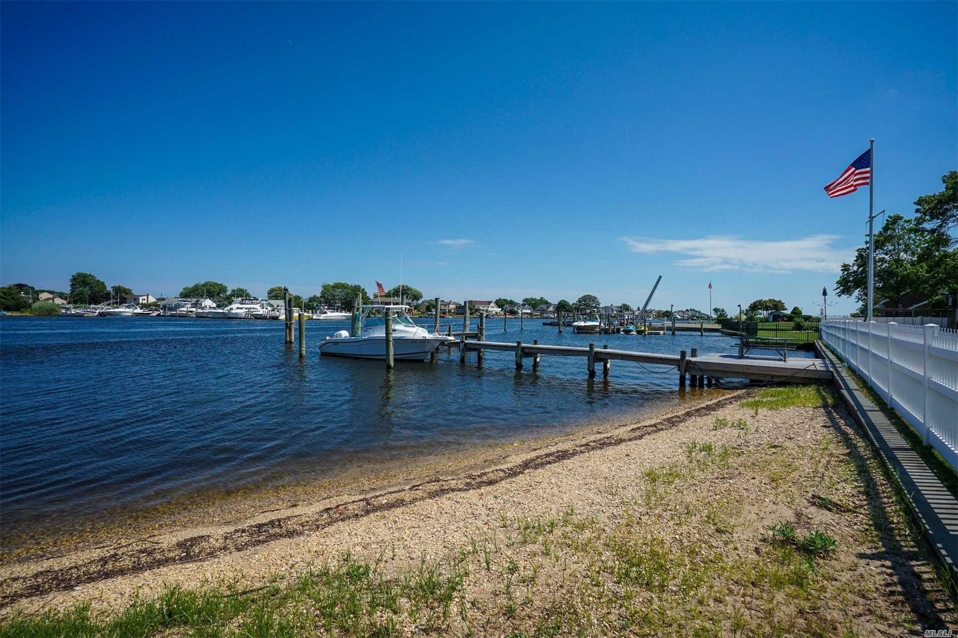 What An Opportunity! This Waterfront Home On Famous Peninsula Dr Has One Of The Best Views On The South Shore! Room For 3 Boats! Private Beach! In Ground Pool! Over 4, 000 Sq Feet Of Wow!!