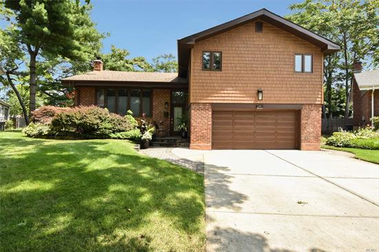 Westbury. Lovely Split In Prime Salisbury Estates Featuring 4 Bedrooms, Spacious, Cathedral Ceilings In Living Room, Updated Kitchen With Granite, Modern Flair, Hardwood Floors, Updated Bath, Den, Open Floor Plan, 2-Car Attached Garage, Updated All Weather Windows, Huge Parklike Grounds.