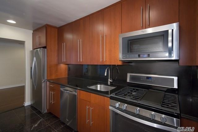 Tuscany Kitchen With Gold Series/ Blomberg Appliances. Granite Kitchen Flooring & Granite Countertops. Washer/ Dryer. Hi Hats, Ceiling Fan, Crown Molding, Two Tone Paint, Marble & Granite Bath, Frameless Shower Doors, Rain Shower Head & 2 Faux Woodgrain Window Treatments.