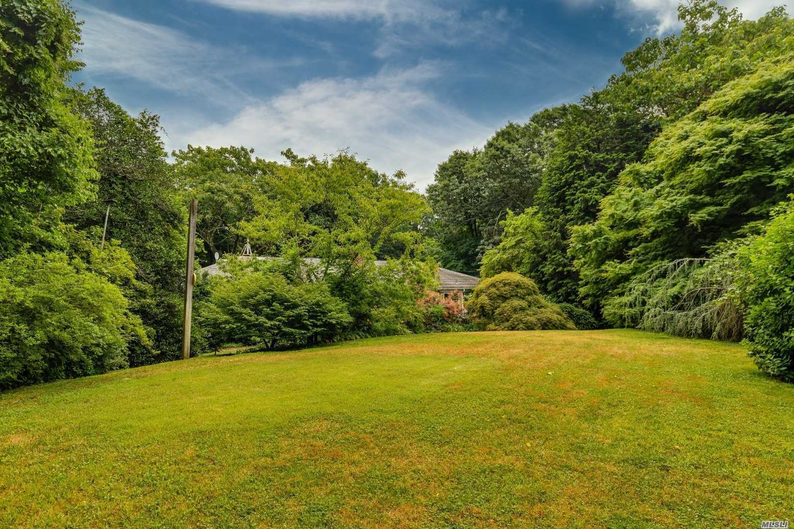 Situated In One Of The Most Sought After Oyster Bay Cove Communities On Over Two Lush & Beautiful Acres Sprawling 4 Bedroom Ranch W/ 2571 Sq Ft Of Endless Possibilities, Hardwood Floors Throughout, Walk Out Basement, Beach & Mooring Rights