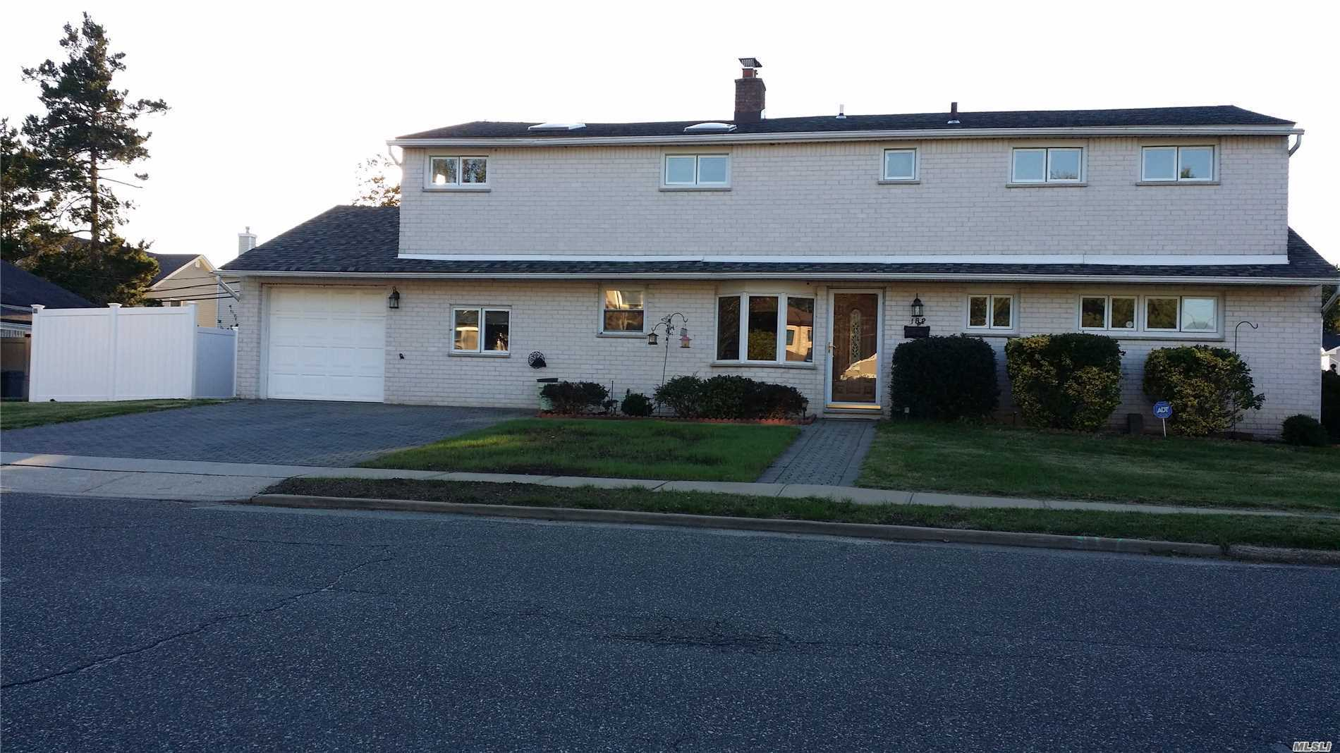 Beautiful Colonial With A 3 Bedroom And 2500 Sq Ft Of Luxury Living Space. Hardwood Floor And 3 Skylights, Updated Kitchen With New Stainless Steel Refrigerator And New Electric Range . New Washer And New Dryer, New Tank Water Heater, New Roof And New Baseboards For The 2 Upstairs Bedrooms, Fenced Backyard .Minutes To Highway. Train And Highly Desirable Syosset School District.