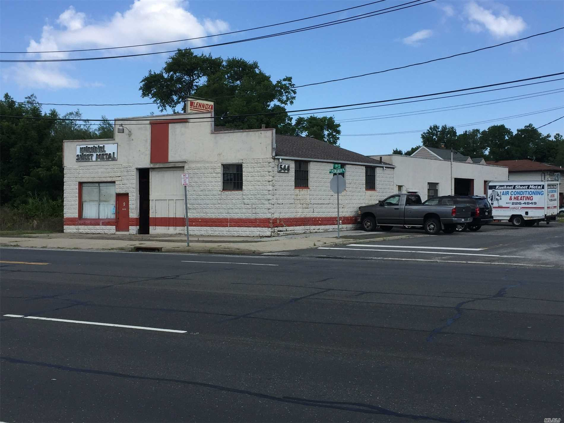 Great Corner Property And Building Right On Montauk Hwy. Extreme Visibility With Very High Traffic Counts. Commercial Business Zone. Was A Sheet Metal Shop. Has Two Bay Doors With High Ceilings. 10 Car Parking. Perfect For Any Type Of Shop Or Warehouse Use. Can Be Office Building Or Retail Store.