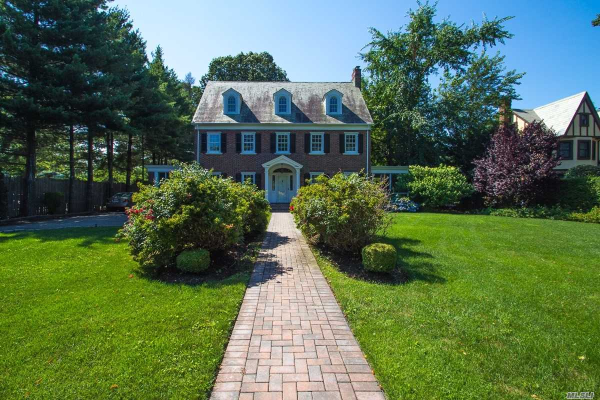Majestic Brick Colonial In The Heart Of Garden City, Set On Over A 1/2 Acre Of Property. Over 4200 Sq Ft Of Living Space Includes 6 Br, 3.5 Baths, Fml Lr W/Fplc, Fml Banquet Sized Dr, Lg Sunroom Overlooking Oversized Backyard, Eik, Lg Family Rm, Office,  3 Season Sideporch , Detached 2 Car Garage, 3 Zone Cac, Gas Heat , Hardwood Floors. Convenient To Lirr, Shopping And Restaurants.