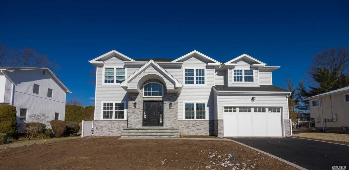 Fabulous New Mid-Block Construction On A Deep 125Ft Lot. House Is North-South Facing! ***Amazing Possibilities For Beautiful Backyard*** Gorgeous Moldings & Mill Work, High End Kitchen. Too Many Details To List! Pictures Are Of 80 Orange Drive. The House Will Have Similar Finishes And Quality Of Construction! Truly A Beautiful House.