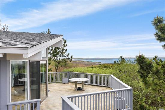 Offering stunning views of Moriches Bay, this raised ranch located in the West Hampton Dunes is the perfect summer getaway. The open floor plan affords a Large eat-in-kitchen/family room with cathedral ceilings, 3 bedrooms & 2 full baths. The lower level features an additional guest room with full bath & outdoor shower. Feasible location to construct house addition & pool. Enjoy summer sunsets of the bay. Close beach & bay accesses.