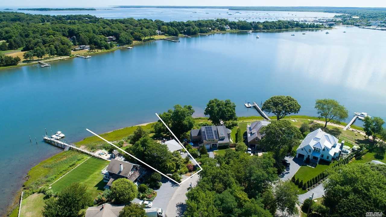 Located In The Desirable Bay Point Waterfront Community, This Well Maintained 3 Bedroom 2 Bathroom Ranch Style Home Is Sited On A Half Acre Property With 160 Feet Of Water Frontage On Sag Harbor Cove. Features Include Central Air Conditioning, Hardwood Floors, Fireplace, Full Basement, Decking, Cedar Shingles, And Updated Roof, Windows, And Heating System.
