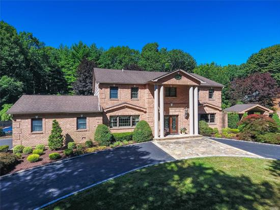 Richly Detailed Spacious & Stately Brick Colonial In Hhh Sd. This Beautiful Home Has Rad. Heat Flrs, Elegant Fdr & Flr, Great Rm, Gourmet Eik, Stunning Mbr W/ Jacz. Bth & Steam Shwr. & Lg Wics. 1st Flr Bdrm W/Fbth, Entertain Guests Inside & Out W/ Movie Seats, Rec. Area, Wet Bar, Wine Cellar, Pool, Tennis Court, Pool House, Surrounded By Nature & Privacy & So Much More!
