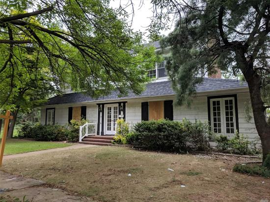 Large Colonial Style Home On A Great Sized Property, Located In The Cathedral Gardens Section Of Hempstead. Excellent Potential & A Blank Slate Ready To Be Made Into Your Dream Home With Wonderful Charm. Wood Floors, Fireplace, Large Bedrooms & Bathrooms, Full Unfinished Basement & The Potential For More Bedrooms/Living Space On 3rd Floor. Come See For Yourself!!