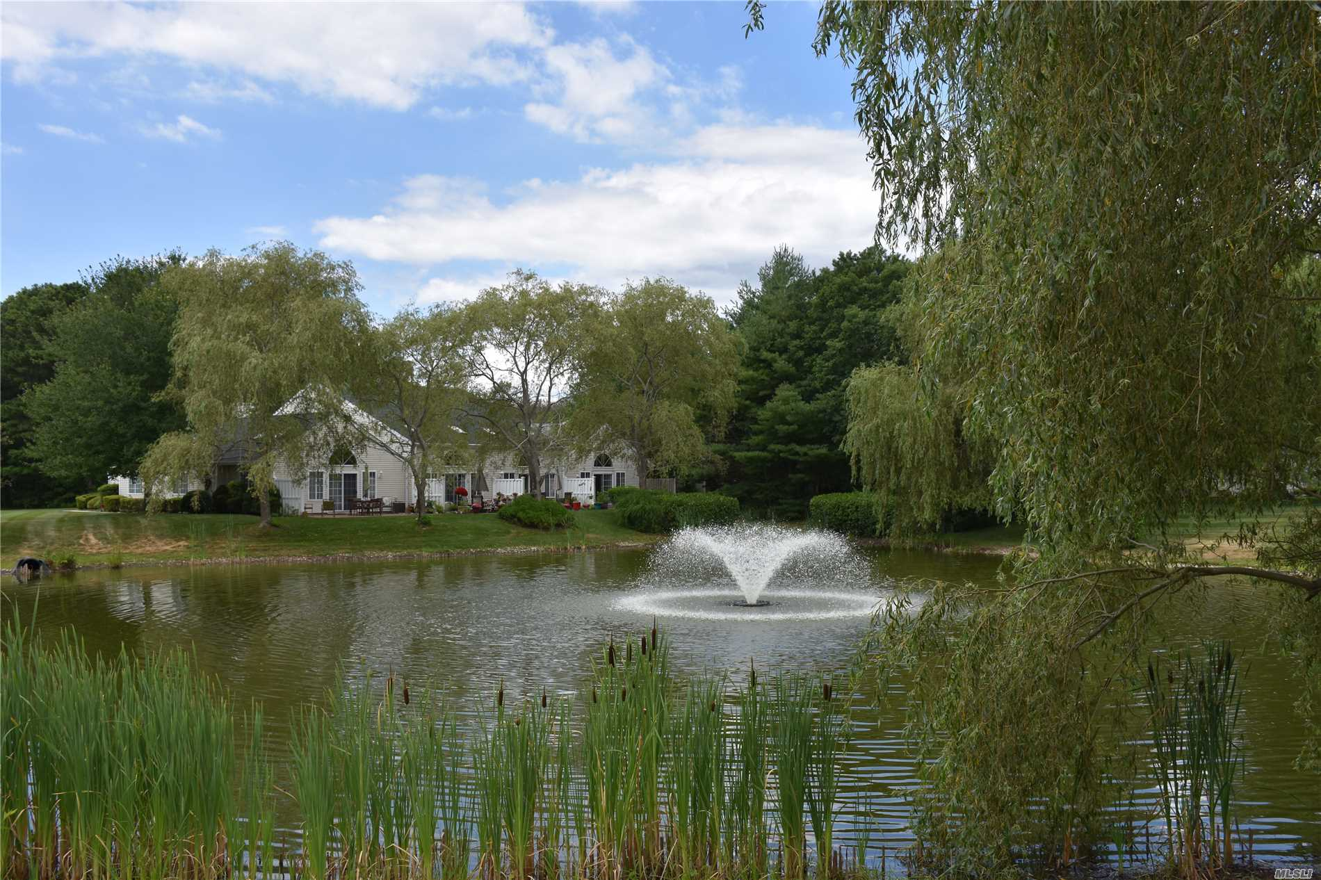 Beautiful Brookwood Ranch Set On A Pond In The Prestigious Gated Silverponds Townhome Community, One Level Unit Features 2 Bedrooms, 2 Full Baths, Spacious Living And Dining Rooms, Eik, Laundry Area, 2 Car Garage, Pull Down Attic Storage, Private Patio, New Washer And Dryer, Upgrades In Both Bathrooms, Newer Garage Door W/Remote, New Lighting, 3 Solar Lights, New Optimum Cable Wiring, 3 Pools, Clubhouse, 3 Tennis Courts, Gym, Billiards, Basket And Handball, Shuffle Board, Playground And More