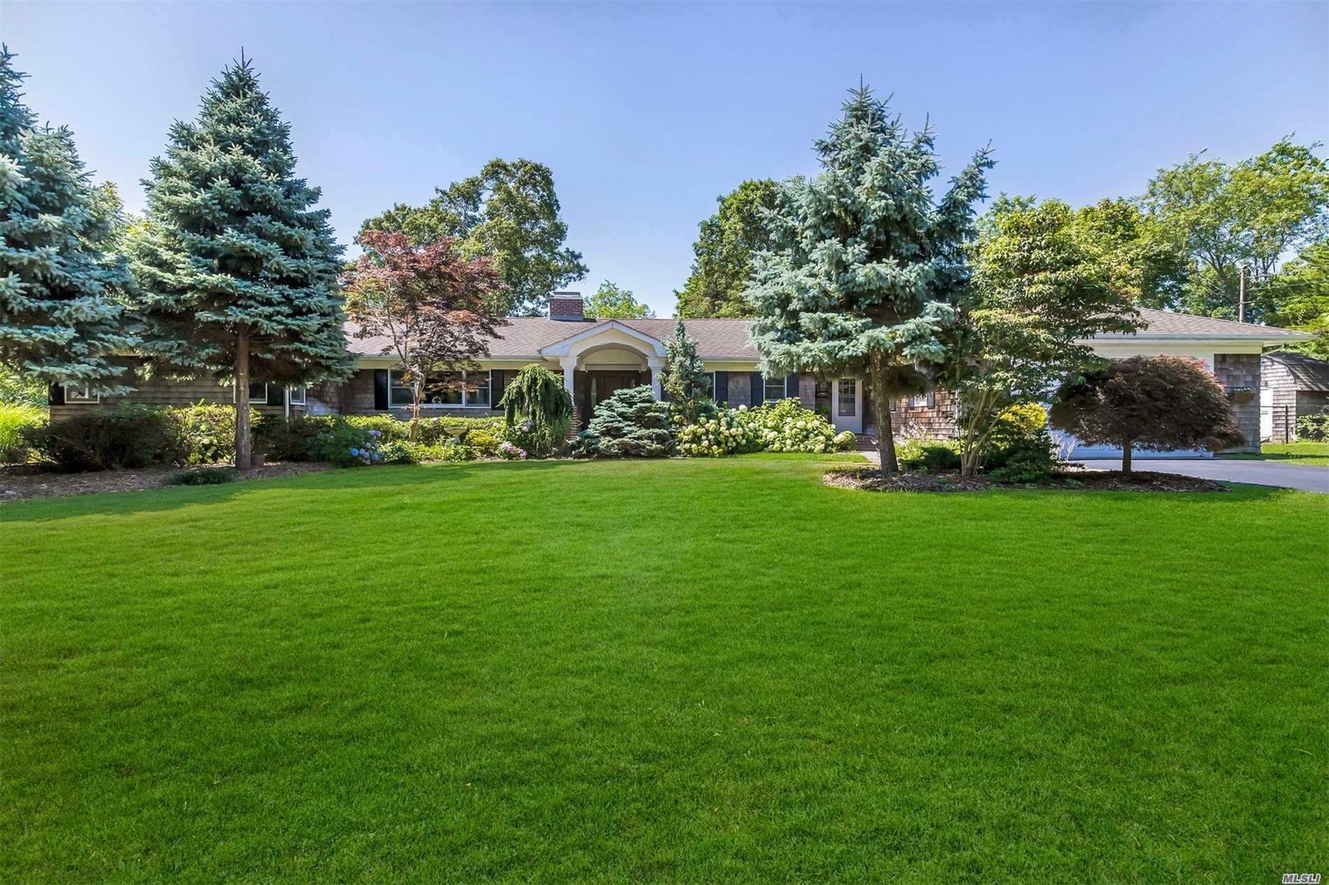 Thoughtfully Designed Sprawling Ranch On A Private Road. Cedar Shingled Exterior & Arched Portico Welcomes You. Slate Floor Foyer W/2 Gorgeous Exposed Brick Walls; The 2nd In The Dining Room W/Wood Burning Fireplace. Soaring Ceilings, Dark Stained Beams & Granite Hearth Accent The Great Room. Enjoy The Adjacent, Glass Enclosed, Billiard Room. Tremendous Chef's Kitchen, Den & Laundry Room.The East Wing Accommodates 4 Bedrooms & 2 Full Bathrooms. One Acre Of Mature Landscaping. One Of A Kind!