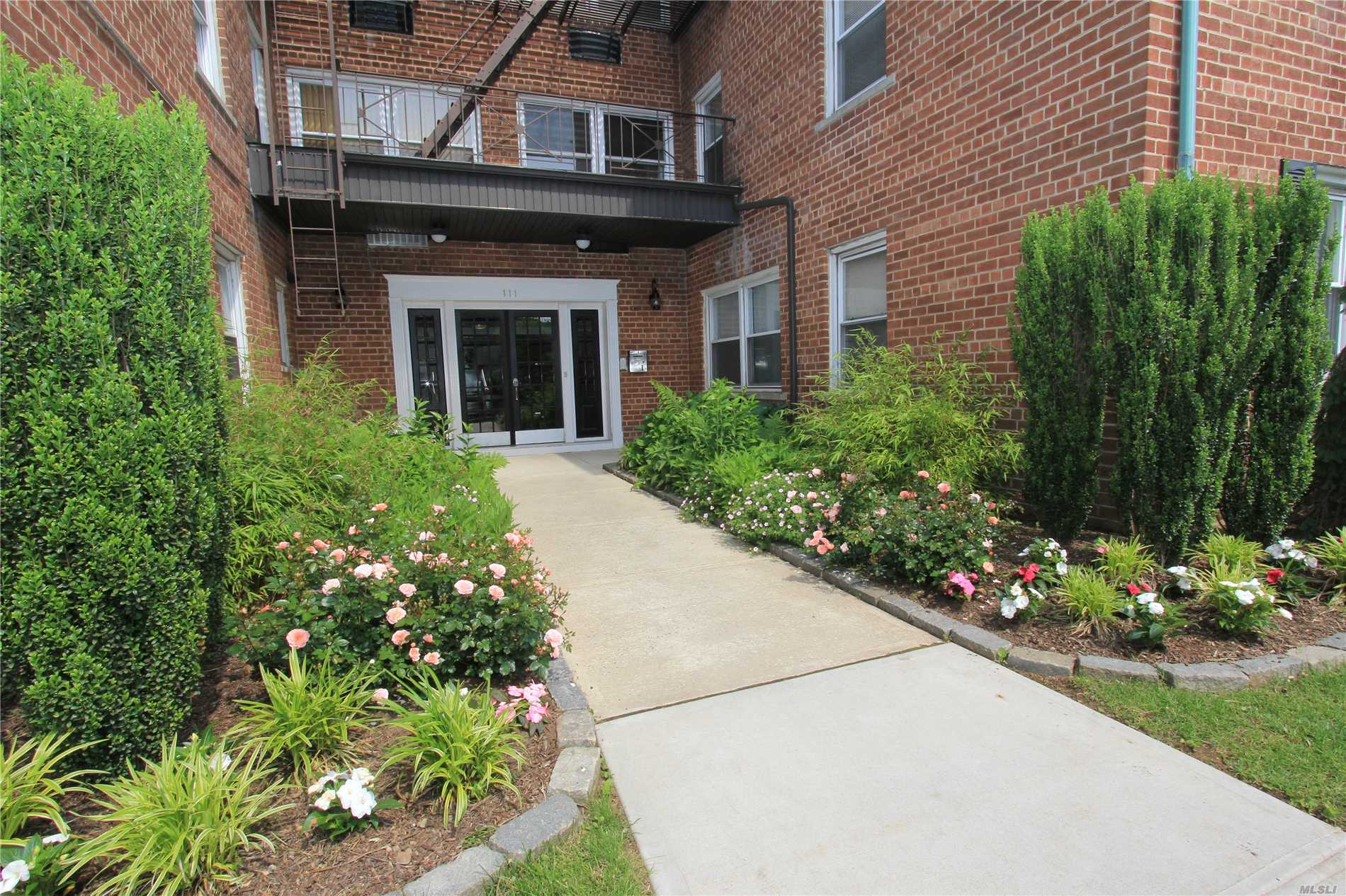 Spacious 1Br Corner 1st Fl. Unit ~ Brand New Living Room Recessed Lighting ~ Brand New Kitchen Tile Backsplash ~ Updated Kitchen W/ Granite Countertops & Stainless Steel Appliances - Hardwood Floors - 4 Closets - Laundry Room @ End Of Hallway - 6 Min. Walk To Village Shopping & Lirr - Rockville Centre Schools - Taxes Included In Maintenance