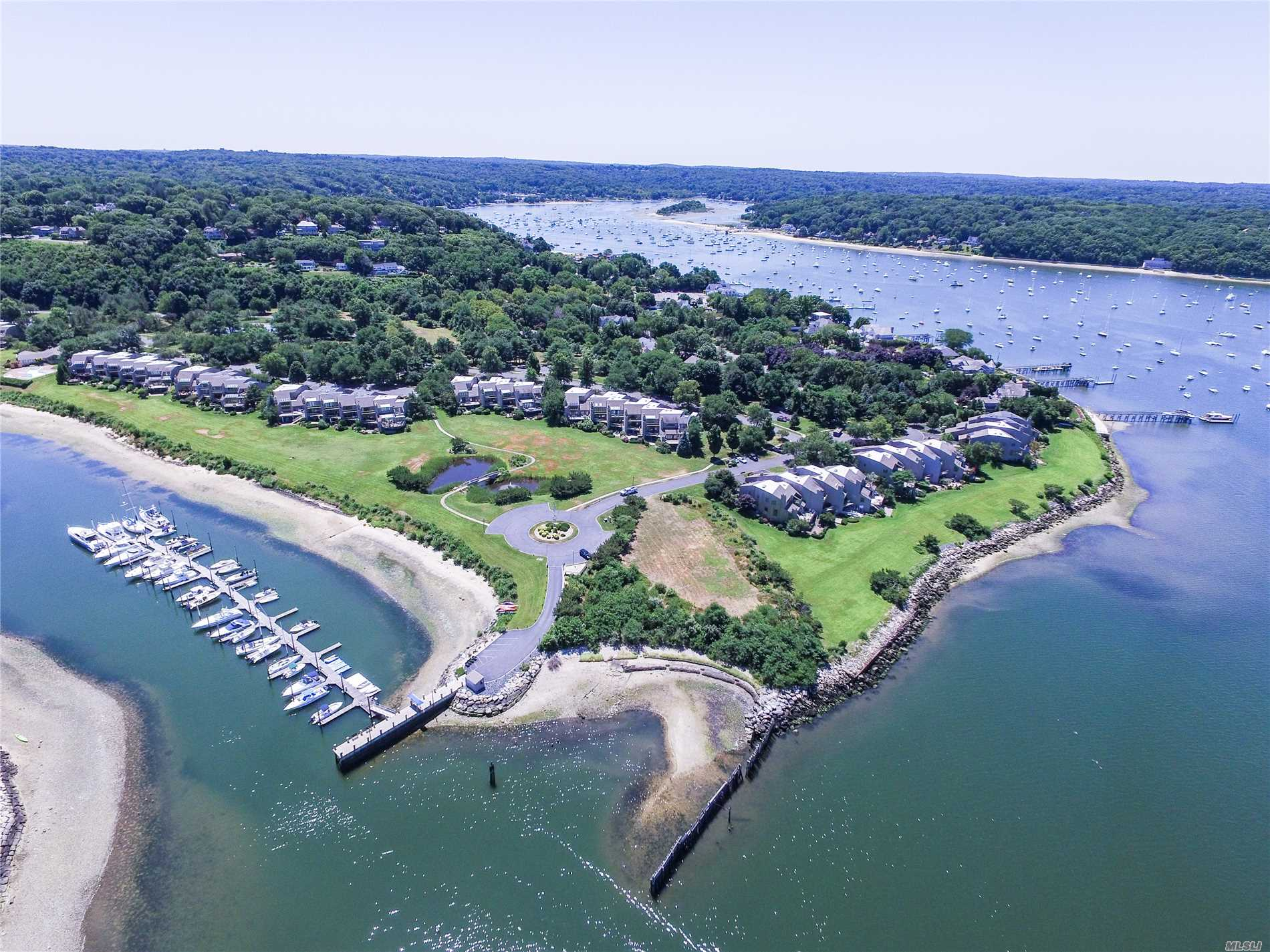 Wonderful Life Style All Within Walking Distance To Historic Village Of Northport. Private Marina With Boat Slip That Will Accommodate A Vessel Up To 65 Ft. This Townhouse Is Being Tweeked To Perfection Now And Ready To Be Sold!!!!!!!