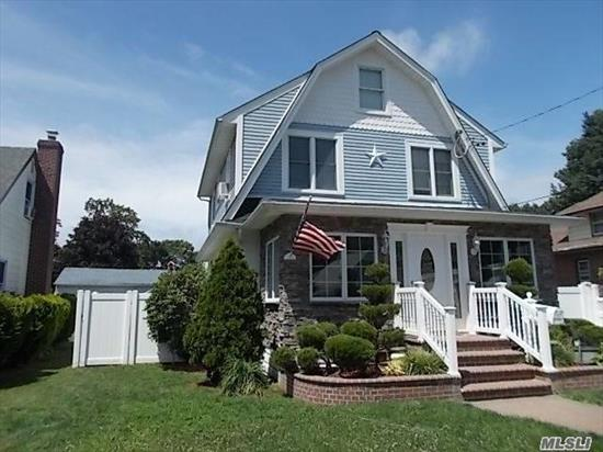 Beautiful Colonial On Tree Lined Street, Over-Sized Lot, 51 X 104. Hardwood Floors, 4 Bedrooms, Gas Fireplace And A Bathtub With Air Bubble Technology. Finished Attic Can Be Used As 5th Bedroom, Dining Room, Enclosed Porch, Mud Room, Full Basement, 200 Amp Electric, Gs, Close To All, Lirr And Plaza Schools, Low Taxes!!