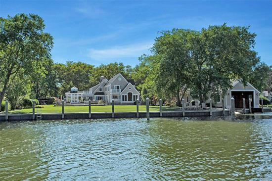 Beautiful Waterfront Home In The O'conee Estates Area On 1.2 Acres, 5 Bedrooms, 5.5 Baths, Living Room With Fireplace, Family Room, Solarium Room With Fireplace & Radiant Heat, Formal Dining Room, Huge Eat In Kitchen With Fireplace, Gym, Office, Central Air... 4 Car Detached Garage & 16X44 Cut-In Boat Slip With Boathouse/Guesthouse Above Featuring A Bedroom, Living Room & Kitchen. The Perfect Backyard For Entertaining With An Extensive Patio, Inground Pool & All New 277' Of Bulkhead.