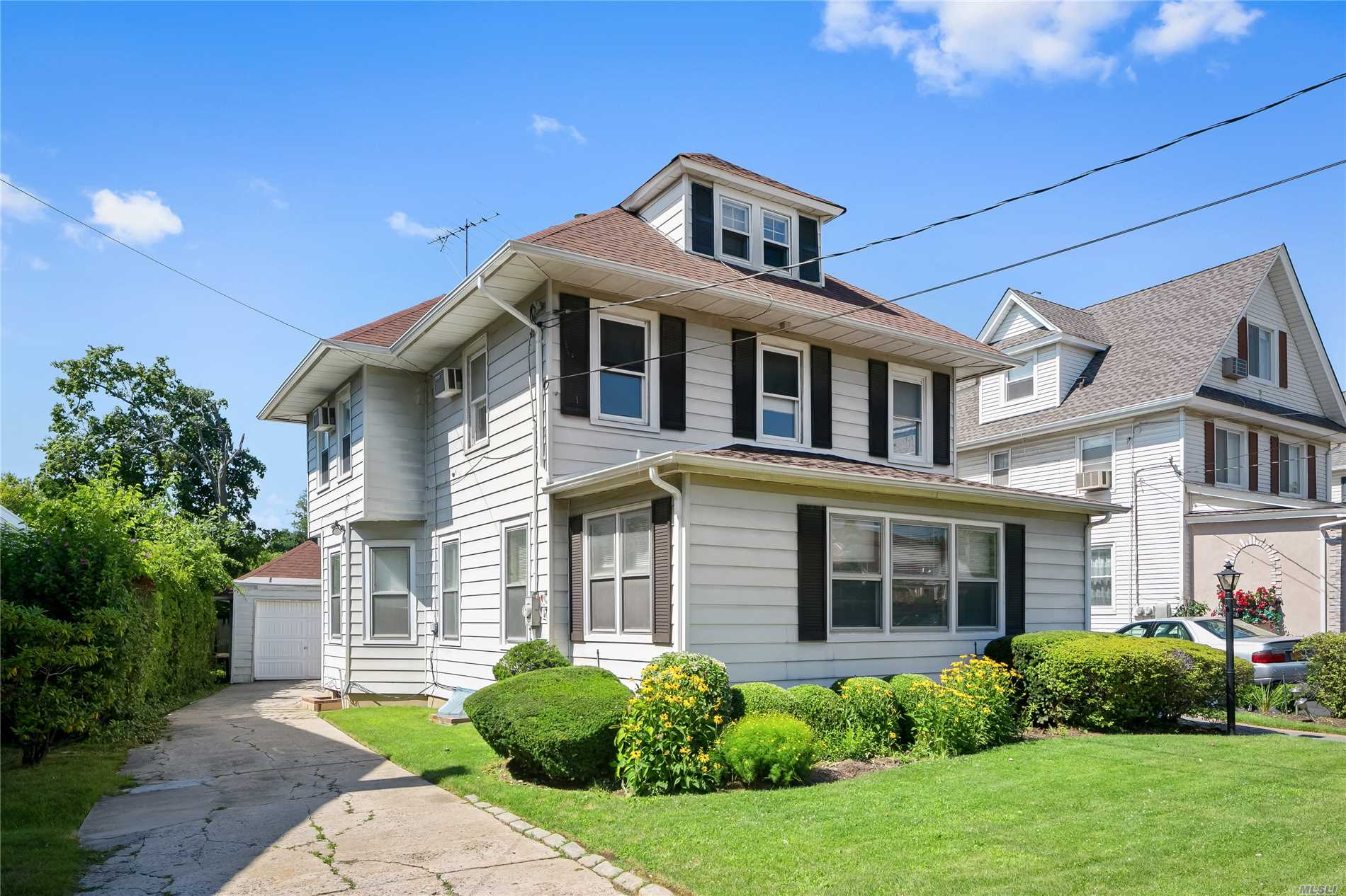 Nice Colonial Home With High Ceilingsand Crown Moldings, 5 Br, 2 Full Baths, Eik, Lr, Dr, Gas Cooking And Heating, Partially Finished Basement, , Hardwood Floors Throughout Home, Finished Attic With Small Br And Stairway, New Patio Pavers, Detached Garage, Walk To Lirr And Many Homes Of Worship.