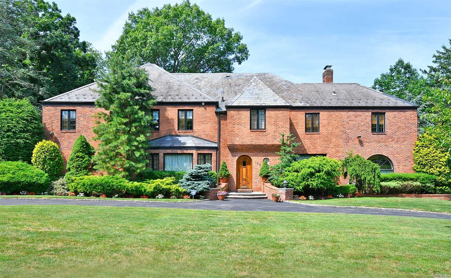 In The Heart Of Strathmore Village Lavish Classic Details Hallmark This Magnificent 6 Bedroom, 5.5 Full Bathroom All-Brick Approx.5, 200 Sq Ft. English Tudor. Situated On Approx. .37Of Park-Like Property, This Home Features Supreme Design Details And Quintessential Elegance.