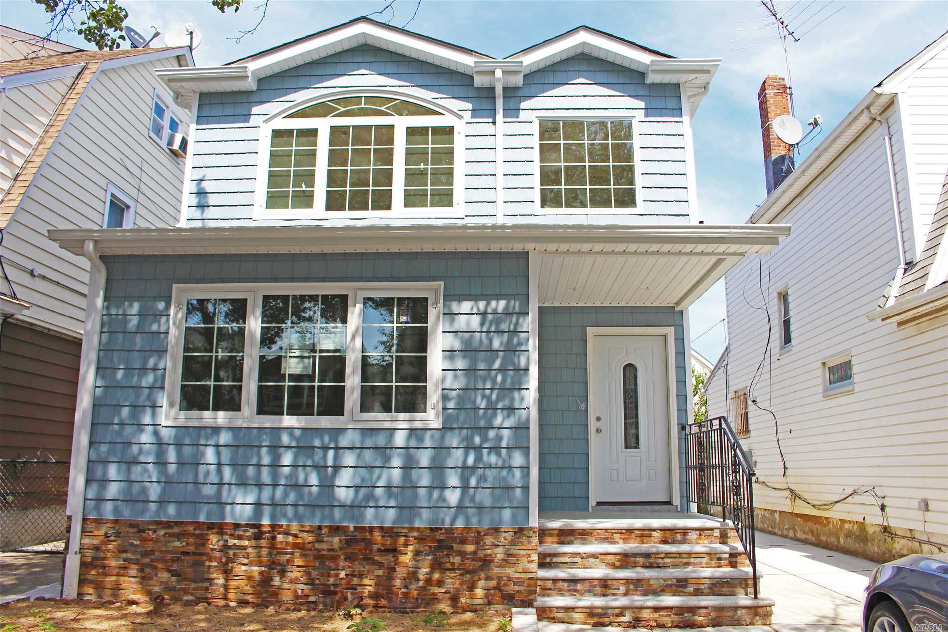 Located Right In The Heart Of S. Ozone Park. Come And Take A Look At This Fully Renovated 2 Family Home. Everything Is Brand New, From Kitchens/Baths To Appliances. Every Bedroom Is Very Spacious And Has Its Own Closet. The Basement Is Completely Finished With Its Own Bathroom And Separate Entrance. This Home Also Features A Private Driveway And Garage. Walking Distance To Train Station/Shopping & House Of Worship. This Home Wont Last Long!