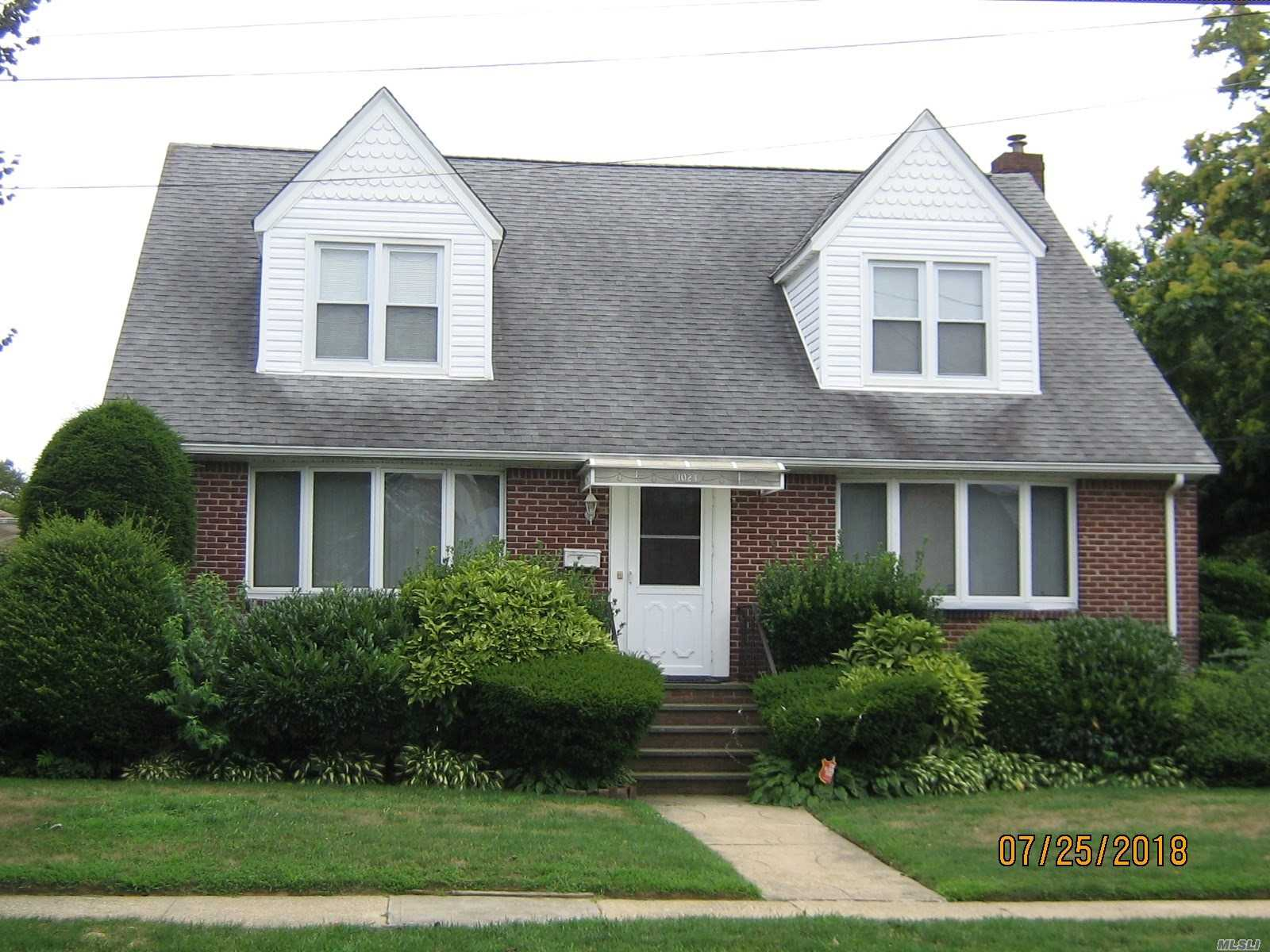 Legal 2 Family. Well Built Home With Large Rooms In Mint Condition. Convenient To Lirr, Shopping, Jfk. Must Be Owner Occupied For 2 Family Certification!