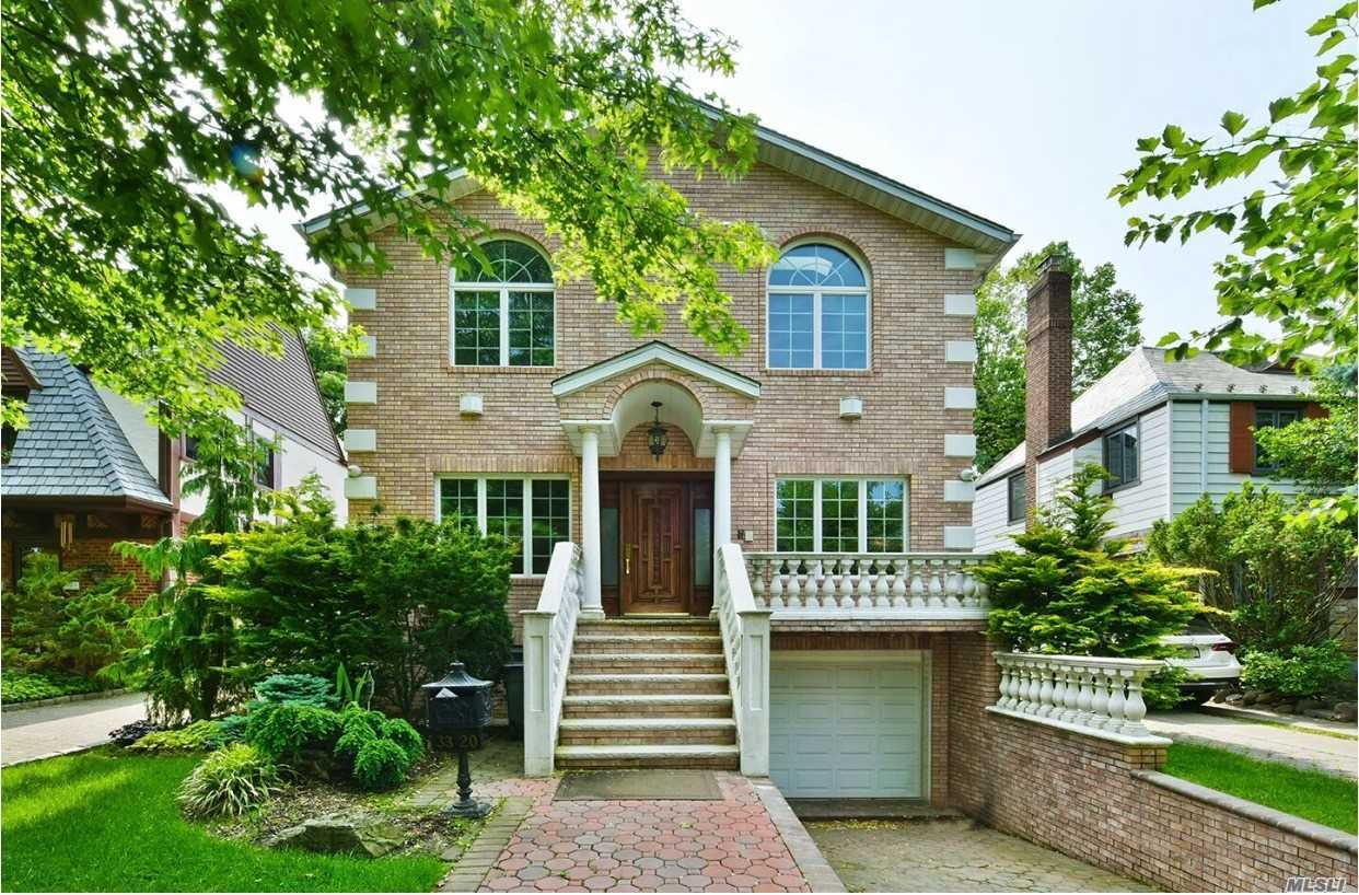 Custom Built By Owner, Large 6 Bedroom Colonial, Grand Living Room With Fireplace, Banquet Sized Dining Room, Chefs Kitchen With Professional Stainless Appliances And Top Quality Crafted Cabinetry. Heated Floors Throughout Entire House On Separate Zones, Big Yard With In Ground Salt Water Swimming Pool And Professional Outdoor Kitchen With Dining Area And Lounging And Water Fall Feature. Walk To Long Island Rail Road, X-Press Bus , Park, And All Located In Top Rated School District.
