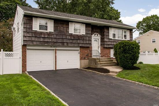 Fantastic Opportunity In Renowned Commack Schools! Spacious Hi-Ranch W/4 Brs, 1.5 Baths, Eik, Lr, Dr, Den And 2 Car Attached Garage. Ose, Huge, Beautiful Flat Yard On 1/3 Acre. Convenient To All Shopping & Highways. Won't Last!