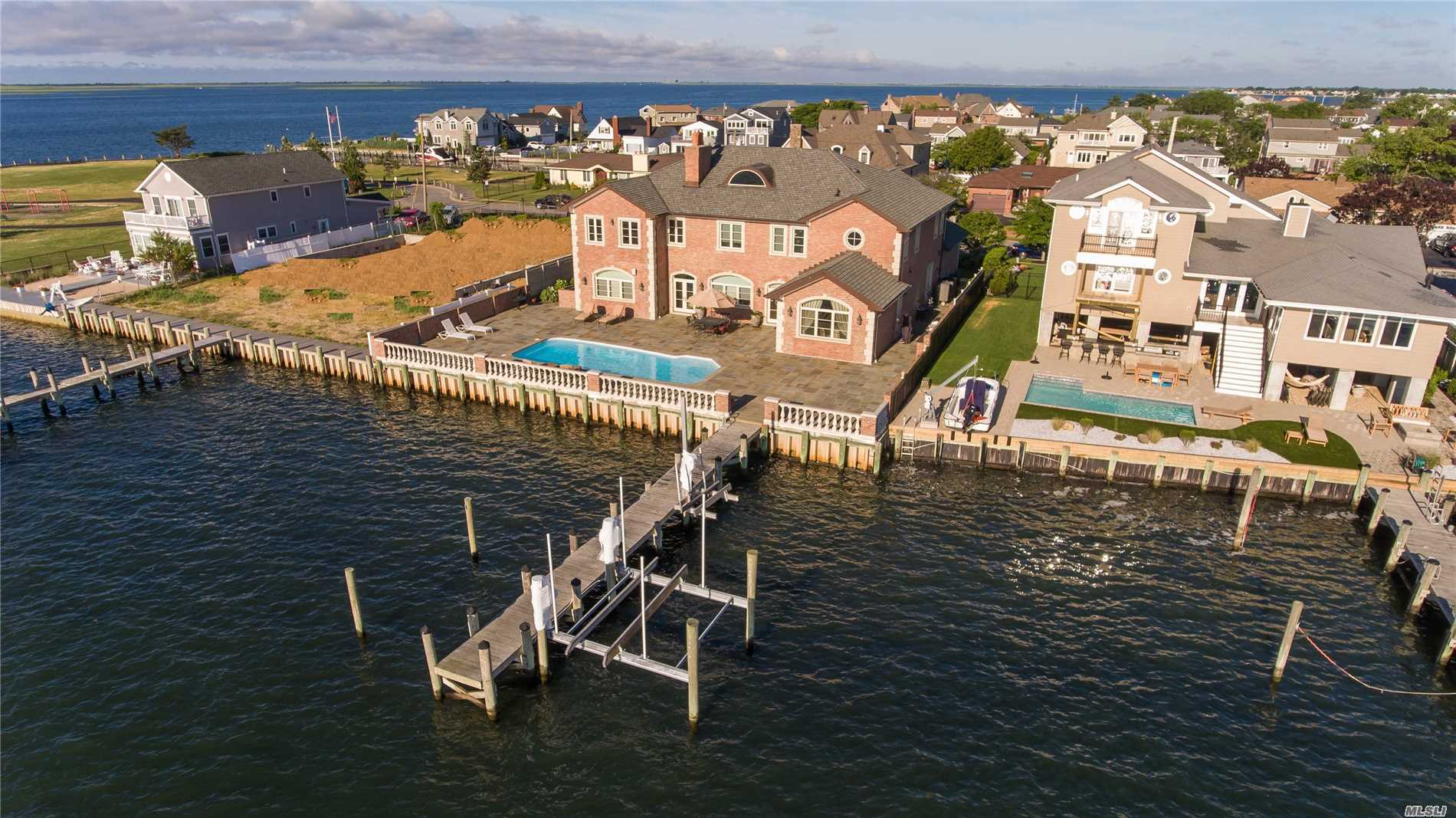 Majestic Brick Bayfront Home Built In 2008 With Every Amenity Known To Man. No Expense Spared & Only The Finest Materials Used. Savor The Beautiful Bayviews & Store Your Boat & Jet Ski Safely On The Lift On The 61 Foot Pier Then Take A Dip In The Saltwater Pool. Livin' L A R G E ! ! !