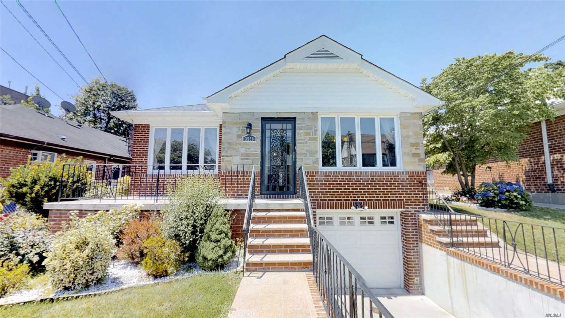 Lovely Renovated Detached Brick Ri-Ranch House With 3 Bedrooms, 2.5 Baths, Formal Dining Room, Eat In Kitchen, Hardwood Floors . New Central Ac, New Roofing.Lot Size 46X100, Building Size 29.67X51 (1513 Sqft) Plus Sunroom 15X19 Legal Extension, Fin Bsmt With Family Room, Garage, 5 Blocks From Lirr, Bus # 28 To Flushing, Convenience To All