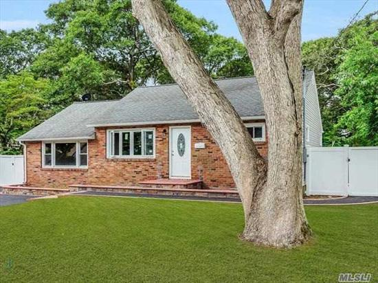 Completely Remodeled Ranch In A Beautiful Middle Country Neighborhood.  New Kitchen, Bathrooms, Floors, Beautiful Brickwork, Huge Detached Two Car Garage On An Extra Large Piece Of Property! Fully Finished Basement With Outside Entrance. Don't Miss This Gem.