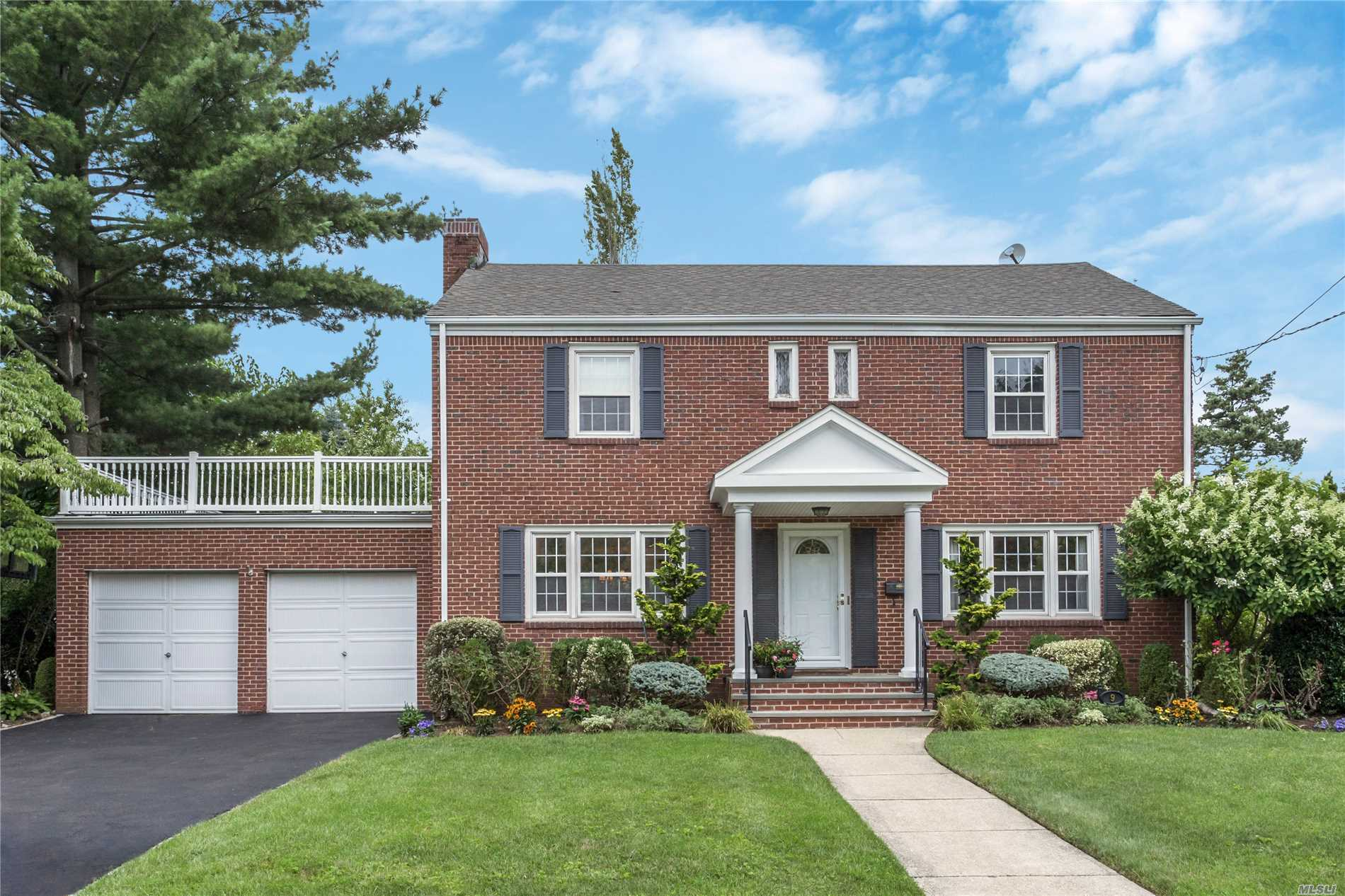This Updated And Expanded Center Hall Brick/Siding Colonial Located In The Western Section On 80 X 125 Private Property Offers An Open Floor Plan With The Eat-In Kitchen/Family Room/Mudroom And Master Suite You Have Been Waiting For! Featuring @3150Sf Of Well-Designed Space With Large Rooms, This Spacious Home Is In True Move In Condition. 7 Zone Gas Heat, Cac And Attached 2 Car Garage. Convenient To Lirr, St. Anne's & Nhp Rd. Shops And Restaurants. This Isn't Just A Home It Is A Lifestyle!