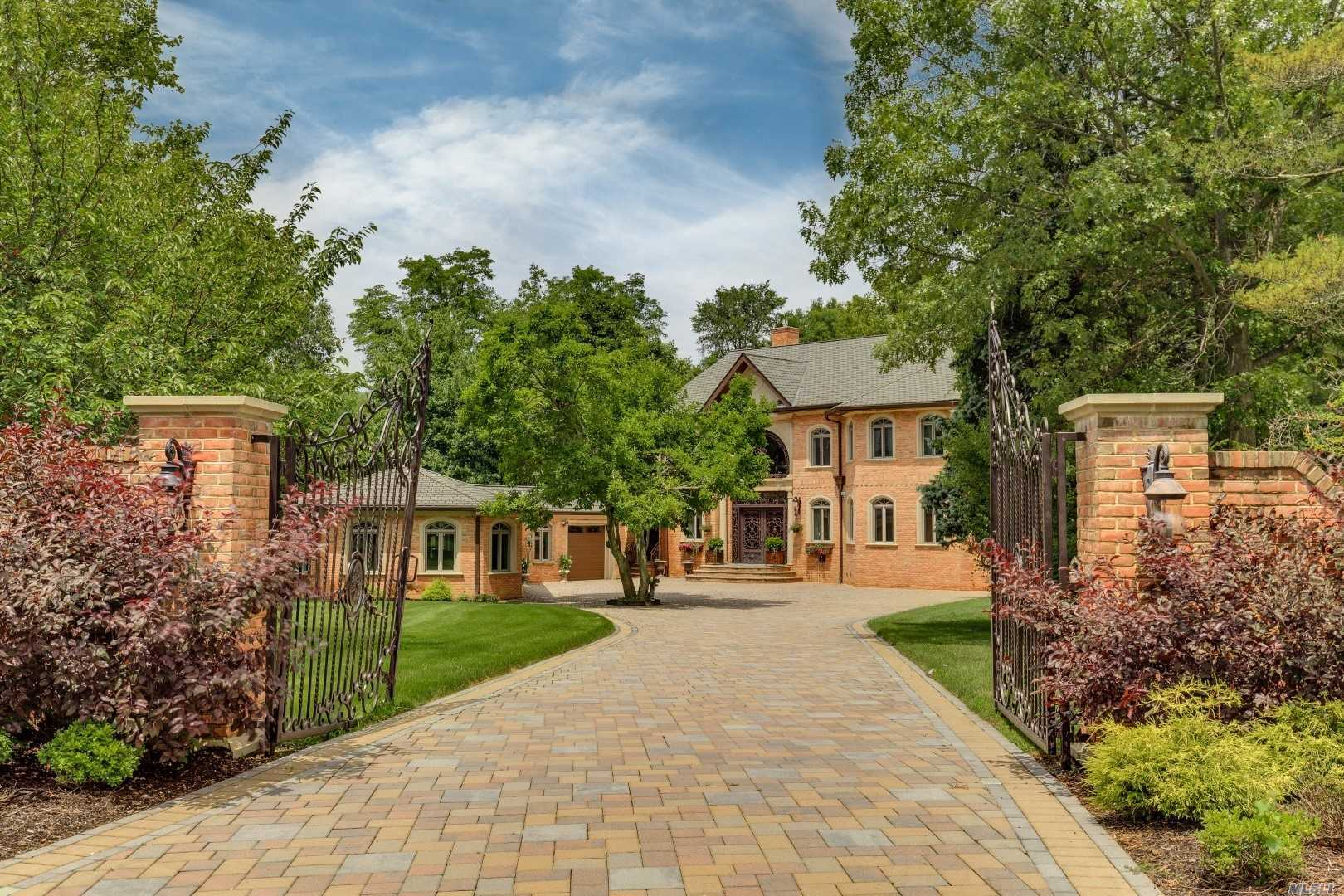 Built In 2006.Spec Cstm Brick 4 Bdrm, 4.5 Bth Col. Grand Ef And Grt Rm Comp W/20 Ft Ceilings, Intricately Milled Tray Ceiling, Mable Flrs W/ Rad Ht, Gas Fplce & Elegant Curved Staircase. Wall Of Glss Drs & Win Fill Space W/ Light.Spac Chef's Kit. Mstr Suite On 1st Flrw/Lux Bth, Possible 2nd Mstr Bdrm On 2nd Floor Ll W/10'Ceilings & Sep Ent. Wonderful Patio Area. Beautiful Flat, Very Prvte Lndscped Acre