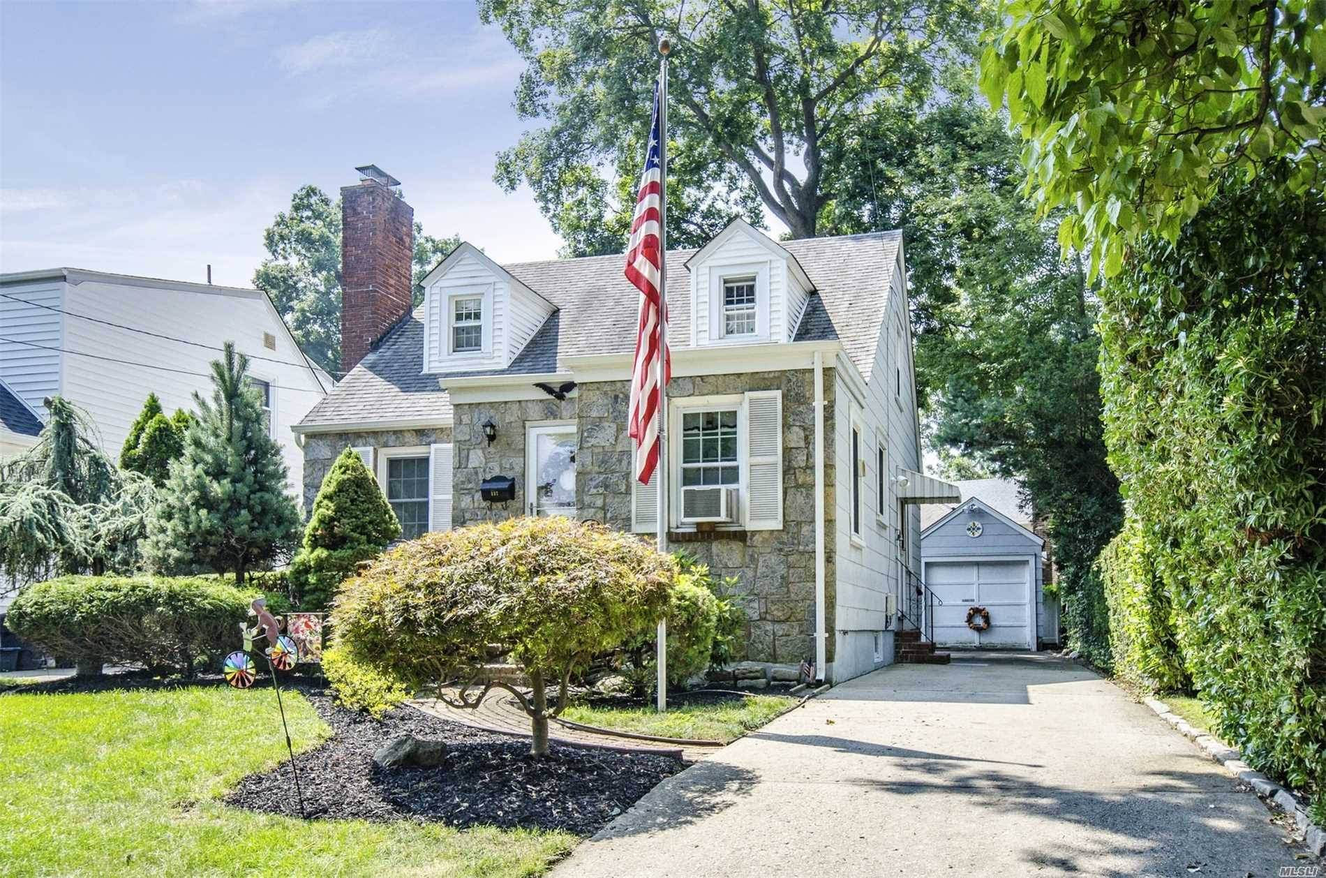 Beautiful Cape Cod Featuring Living Room W/Fireplace Hardwood Floors 3 Bedrooms 1.5 Baths Gas Heat 1 Car Detached Garage