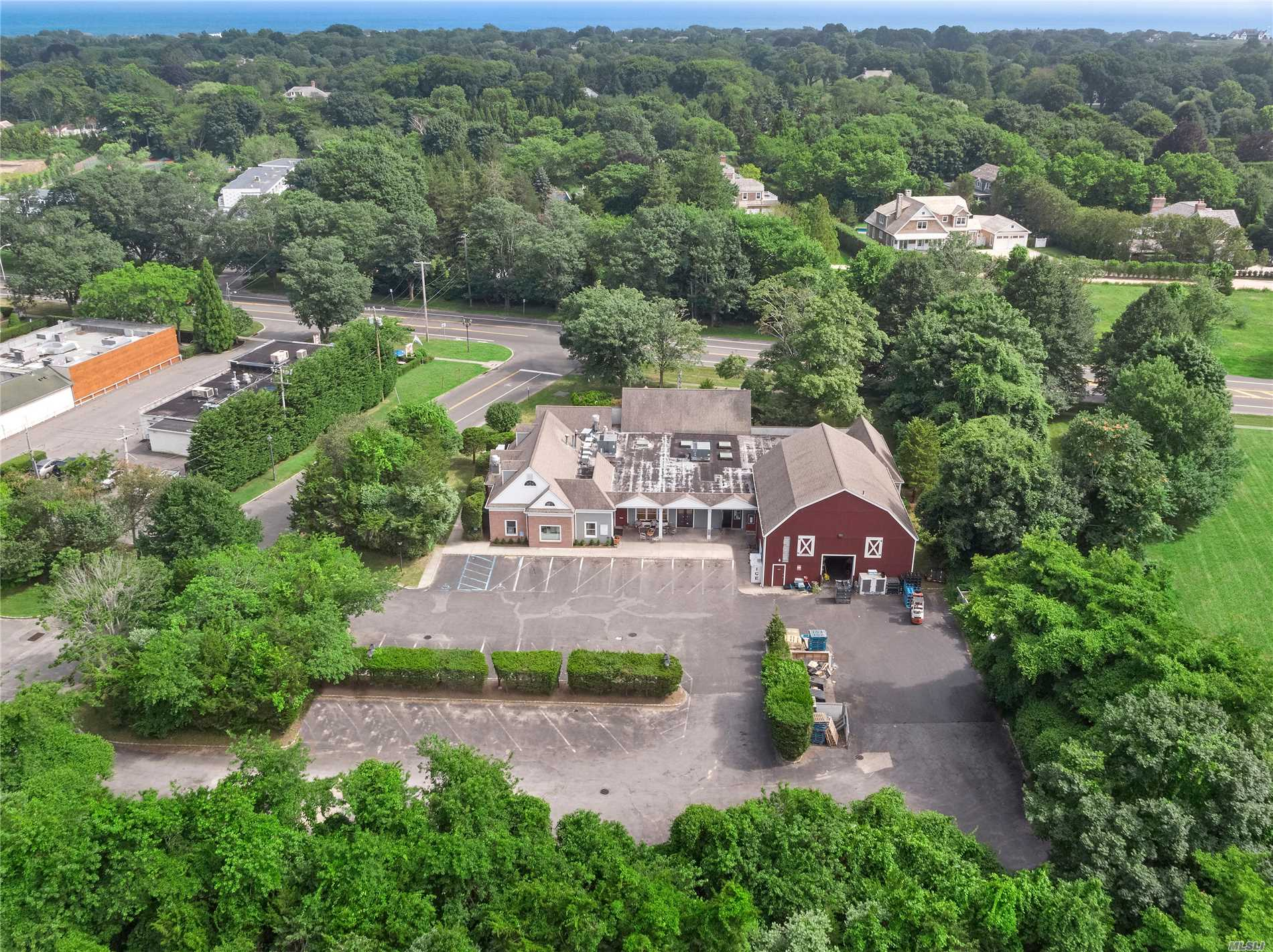 Located Just Outside East Hampton Village Off Montauk Highway Is This 10, 856 Sqft +/- Commercial Building. The Property Is In A High Trafficked Location On 1 Acre With 45 Parking Spots. There Are Three Different Units In The Building With Four Half Baths. The Building Is Zoned Nb= Neighborhood Business. Please Contact Us For More Info.