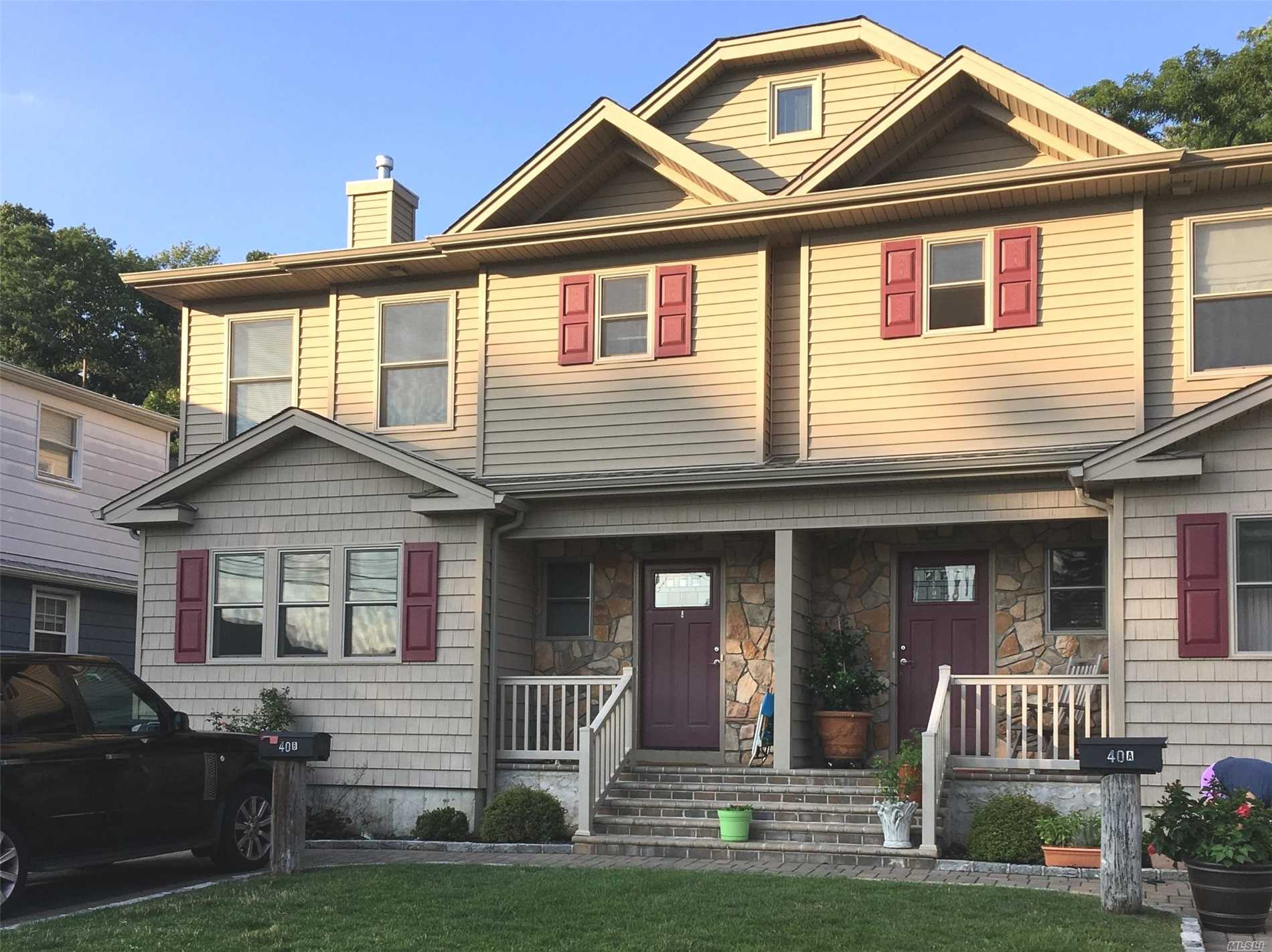 Fabulous Two Family Home On Quiet Road. Large Family Room And Living Room With Doors To Deck And Yard. Three Bedrooms, Plenty Of Closet Space, Full Finished Basement. Close To Manorhaven Community Park, Beach And Pool.
