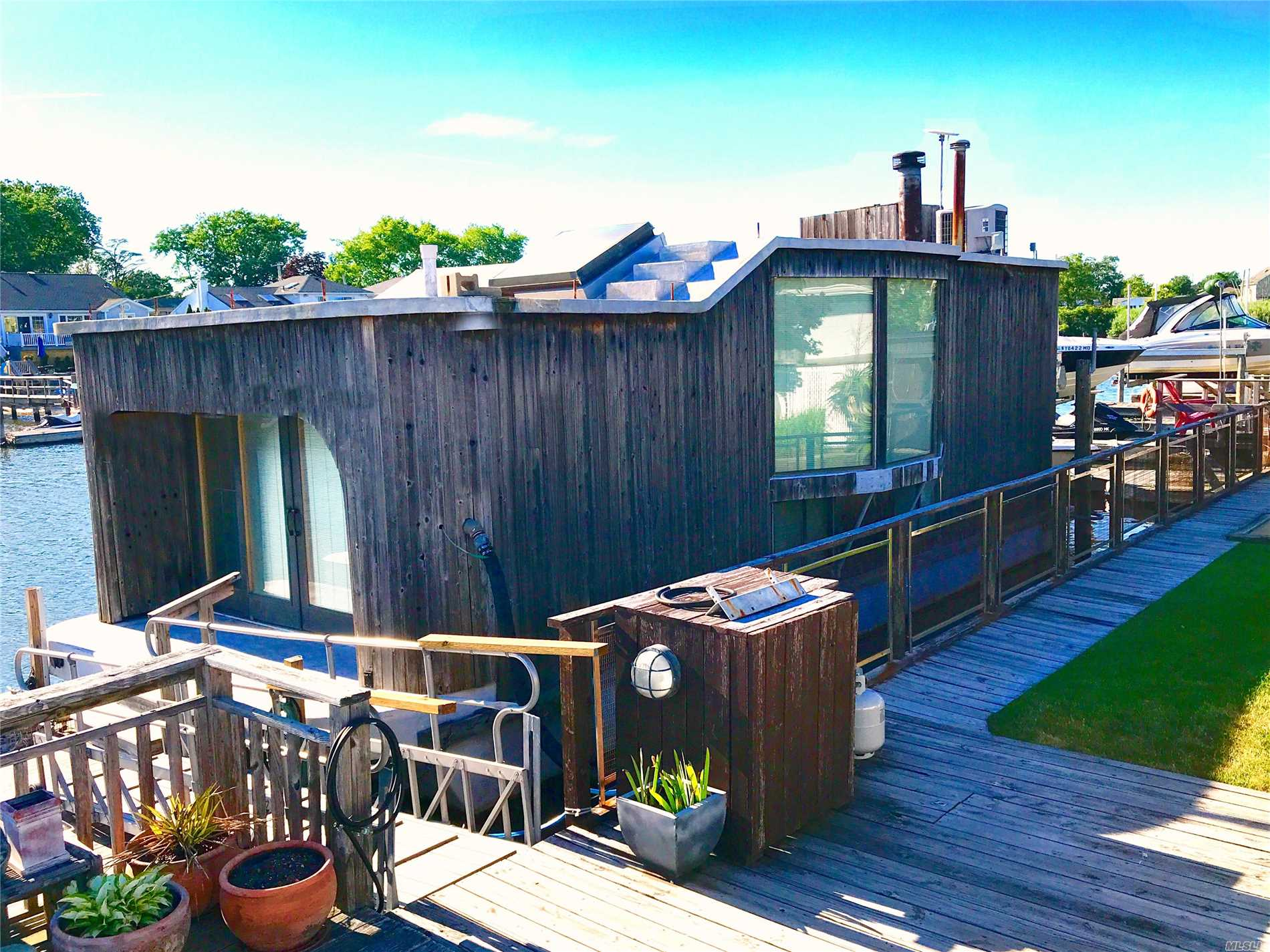 Realize Your Dream Of Living By The Water In Bellmore By Owning This Unique 2 Level Single Family Floating Home Constructed On Fiberglass Barge, Offered At $299, 000. Unbelievably Low Taxes-$1, 190 W/Star Exemption! Grandfthrd By County W/Perm.Residence Status. 4 Rms-Master, 2nd Bdrm, Fbth On Lwr Level. Kitchen Wi/Gran Cntr, Ss Apps, Gas Cooking & Sliders To Small Deck. Liv/Dinrm W/6 Full Length Wndws, Skylht & Wood Burning Frplce. Front Yrd W/Deck, 2Car Drwy, Shed & Ig Sprnklr.Cac, Wsh/Dry & More!