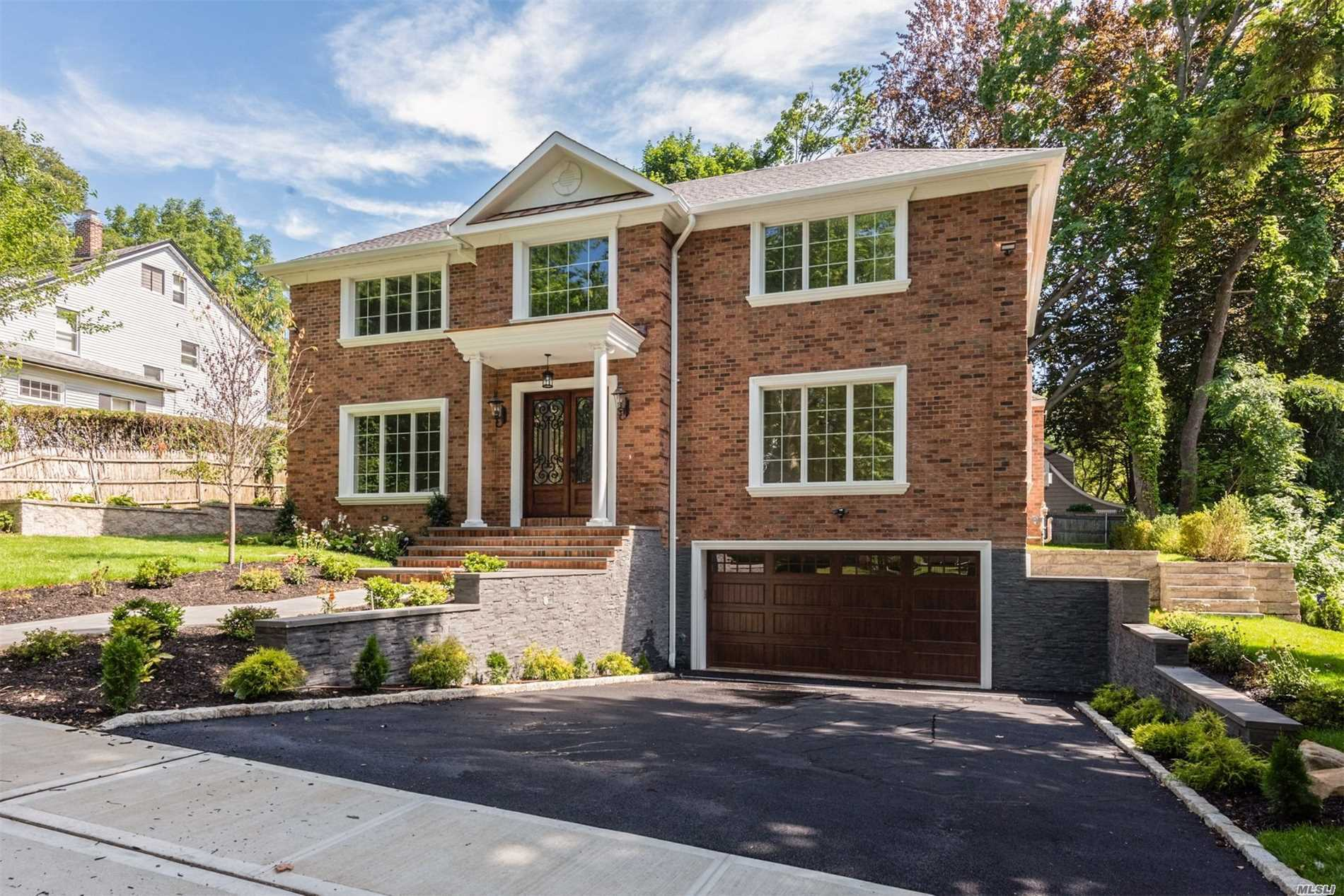Magnificent New Construction, C/H Colonial Built With Superb Craftsmanship And Architectural Design. Excellent Home For Entertaining & Family Living. 10 Ft Ceilings, Double Story Family Room, Elegant Wood Floors, , Chef's Eat-In-Kitchen With Top Of The Line Appliances, Full Finished Basement, Radiant Heat In Foyer, Kitchen And Bathrooms, Central Vac, Alarm, Ready For Camera Surveillance, Energy Star Home. Saddle Rock Elementary And South Middle And High Schools. Only 3 Blocks To Lirr