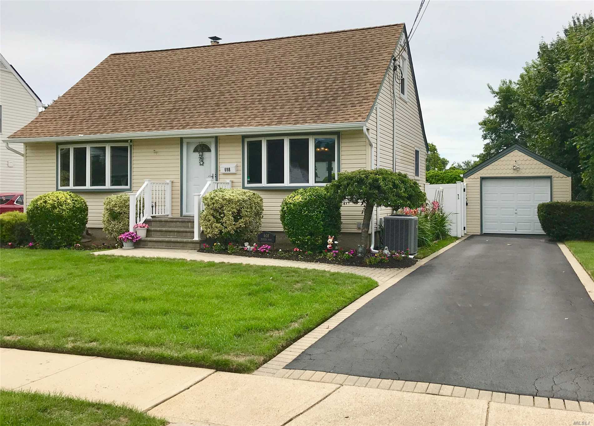 Beautiful New Englander Cape Cod, Open & Spacious Floor Plan, Kitchen W/ Atrium Doors Leading To Rear Deck With Retractable Awning, Updated Bath, Hardwood Floors, Immaculate, Newly Finished Basement. Central A/C, 200 Amp Electric., Prof. Landscaped W/ Flowers Galore, Sprinklers, A True Beauty!