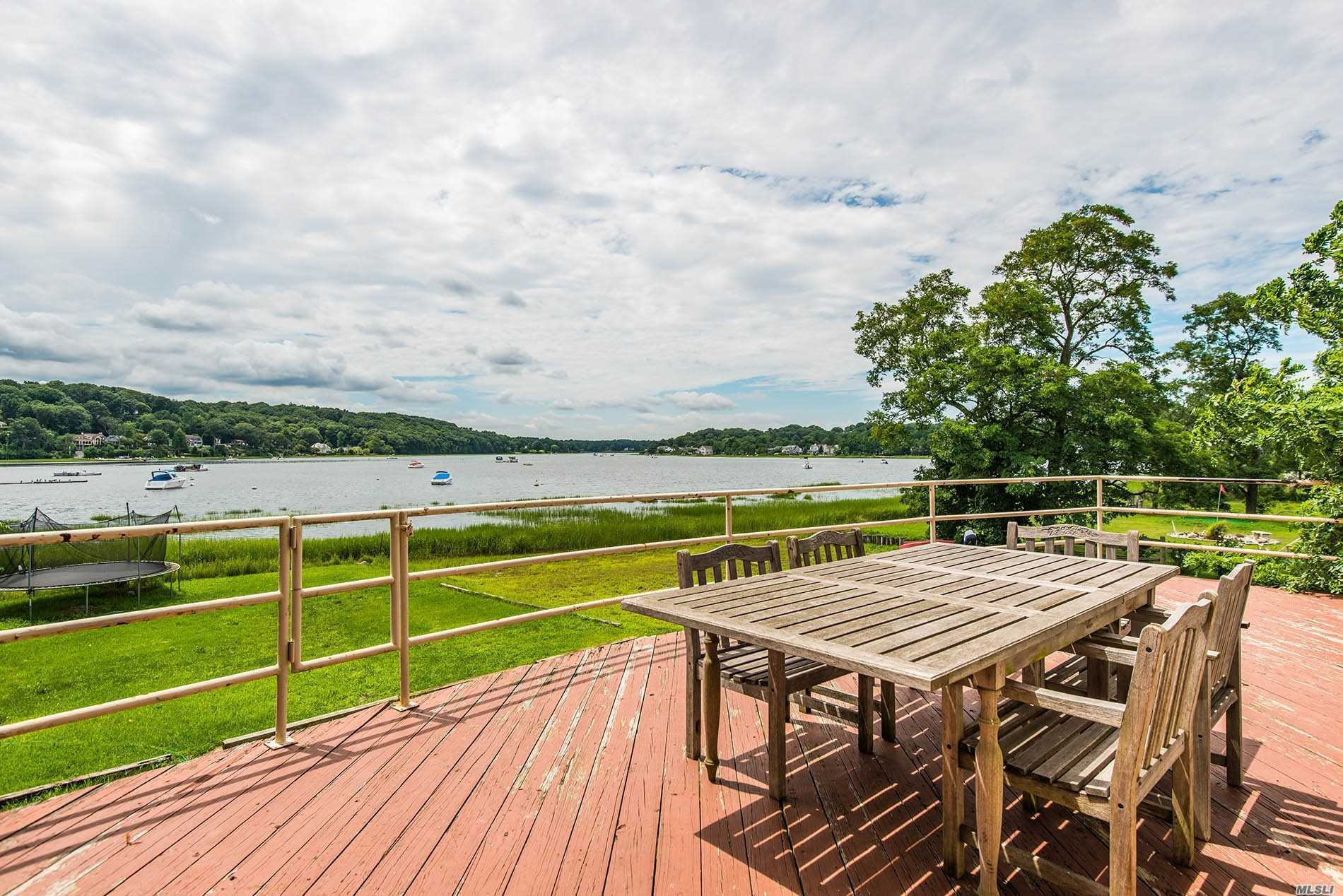 Phenomenal New Price! Waterfront! Extended Home Offers An Incredibly Versatile Floor Plan W/ 5 Beds, 4 Baths & Breathtaking Bay Views. This Spacious Residence On A Deep Lot Is Brimming W/ Potential To Landscape & Make Your Own. Granite Kit, Home Office, 2 Fplcs, 2 Car Garage. Gas Fuel, Cac. Year Round Or Summer Getaway. Great For Multigenerational Living Or House Guests. Sound Side Beach Rights And Bay Side Riparian Water Rights! Must See!