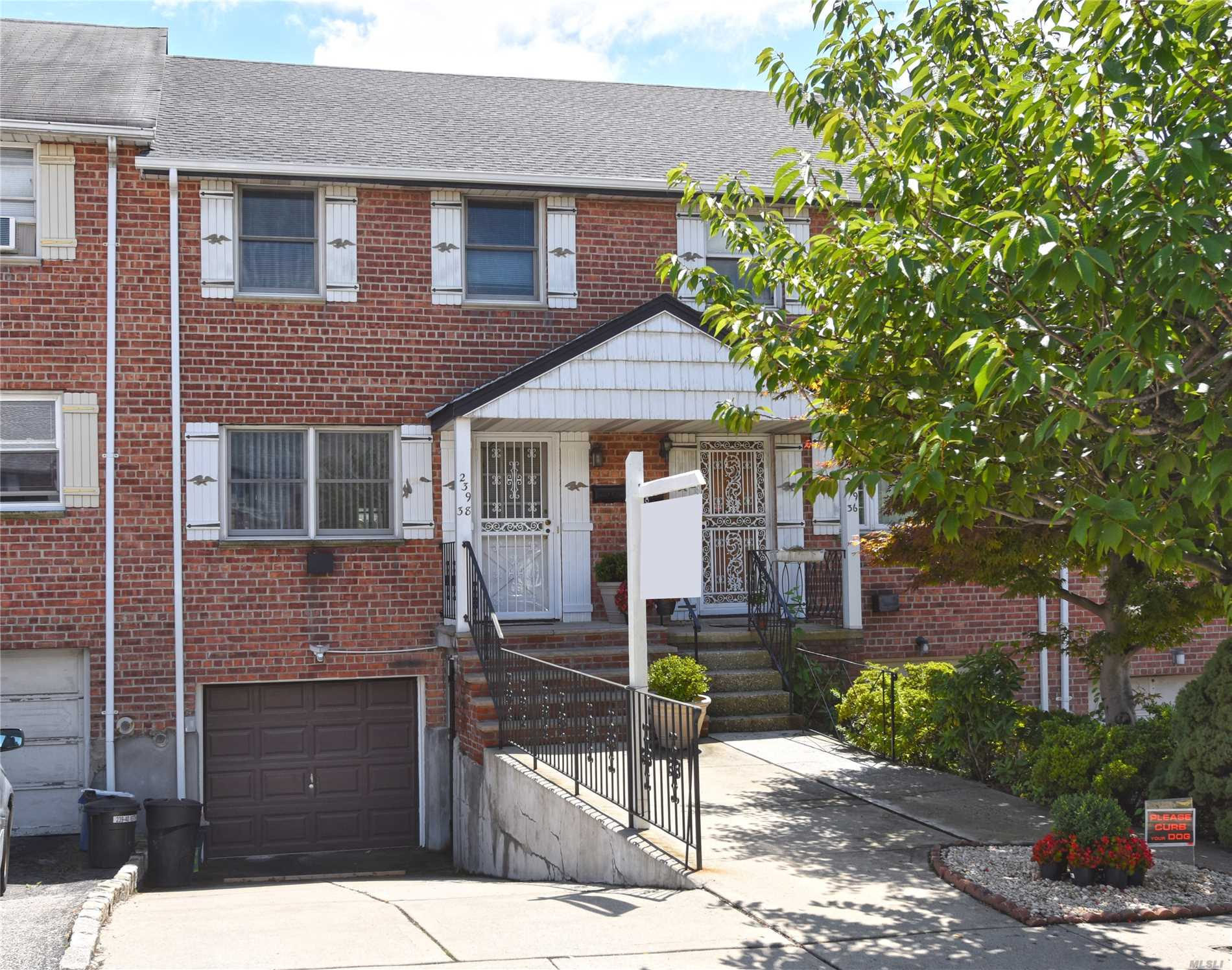 All Brick One Family Is Centrally Located In Douglaston On A Quiet Residential Block. Beautiful Open Plan Layout In Super Mint Condition. New Kitchen & New Bath & New Central Ac. Sliding Doors Off Of Large Eat In Kitchen Which Leads To Private Yard. Finished Basement With Sep/Ent. Great Flow Of Entertaining.Walk To Fairway Supermarket And Buses. School District 26.