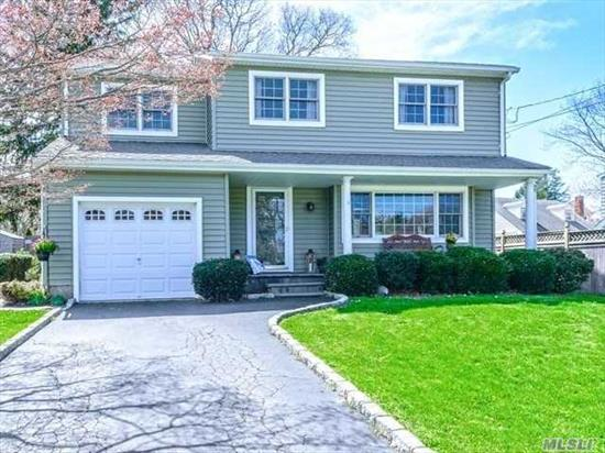 Updated 4 Bedroom Colonial, Midblock, Location In Highly Sought After Neighborhood. Hardwood Floors Throughout New Finished Lower Level. New Siding And New Roof. Gas Store + Gas Line In House For Easy Conversion. Wood Burning Fp In Den W/ Sliders To Powered Patio Overlooking Igp.