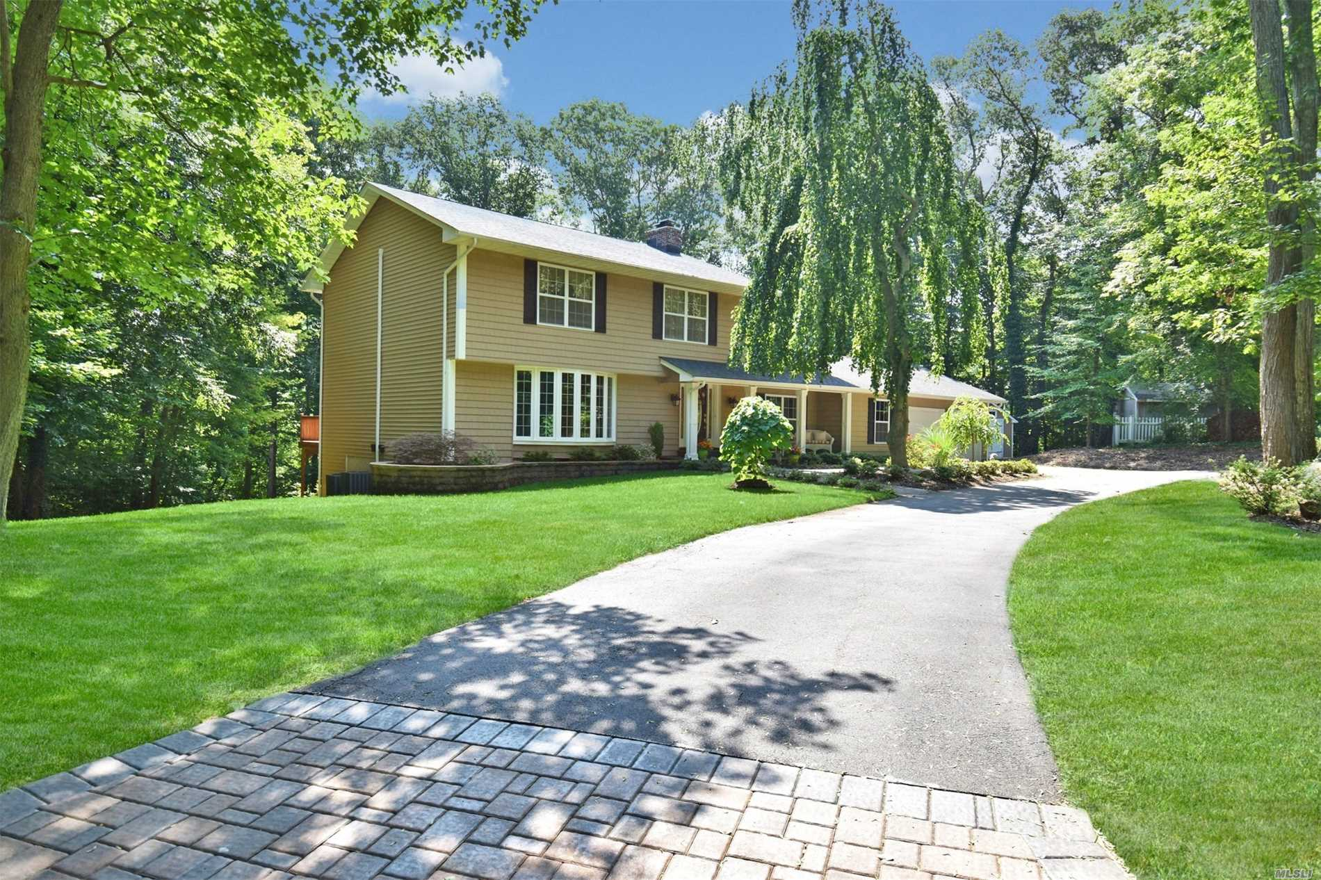 Diamond +++ Luxuriously Renovated Center Hall Colonial With Open Floor Plan Set In Tranquil Cul-De-Sac./Court. This Impressive Home Boasts, Wainscoting, Hardwood Flooring, Crown Molding, Cozy Fp, Vaulted Ceiling, Custom Granite Eat In Kitchen W/Center Island, S.S. Appliances, Deluxe Baths, Windows, Cac, Roof, Sprawling Deck, Front Porch, .80 Acre, And More. Close To Stony Brook Village & Stony Brook University. In Sought After Prestigious Neighborhood & Three Village Schools.